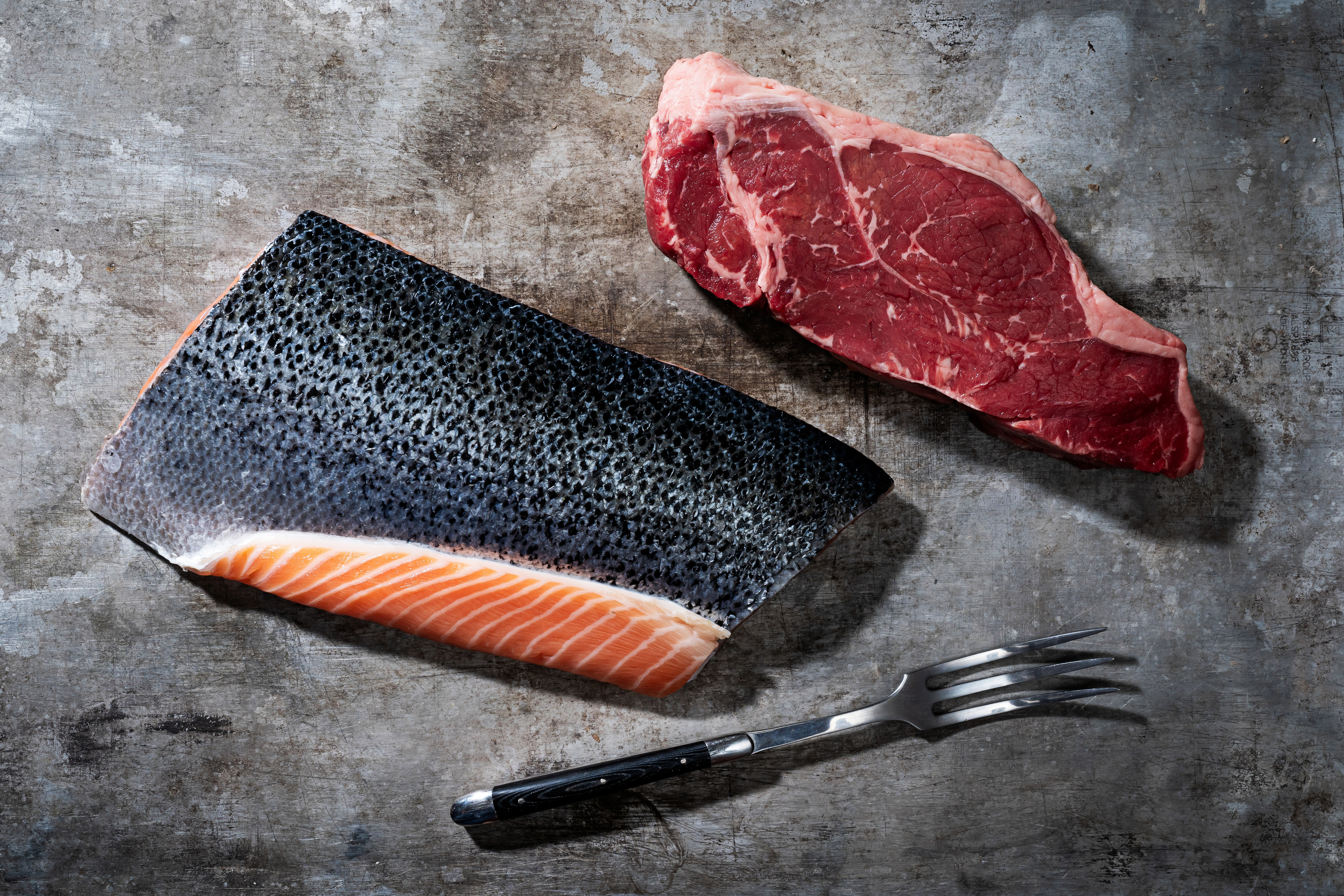 A piece of salmon and red meat.