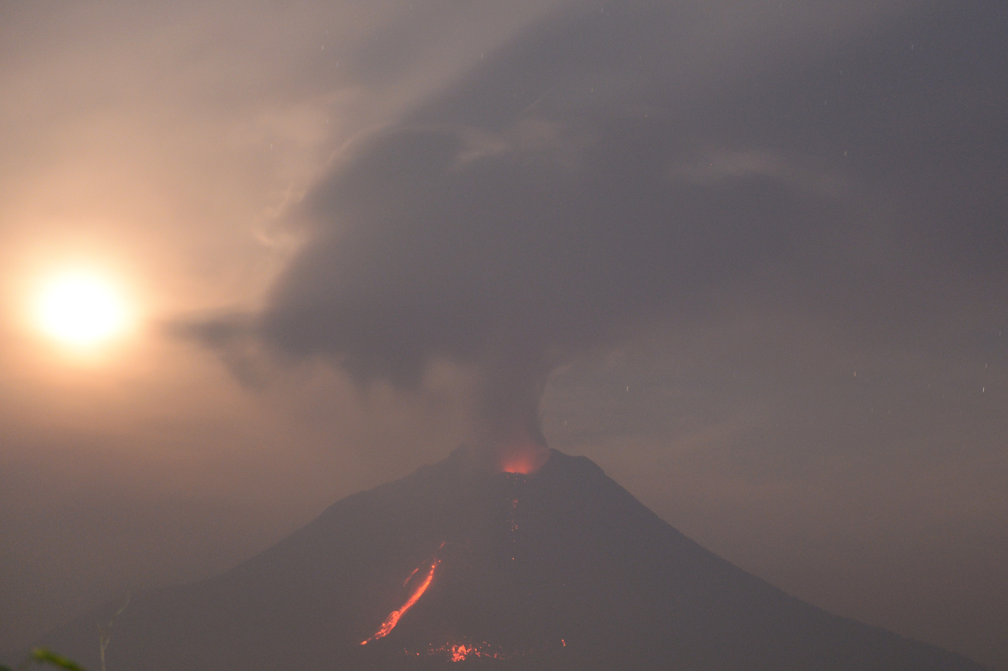 The sun shines dimly through ash after a volcanic eruption.