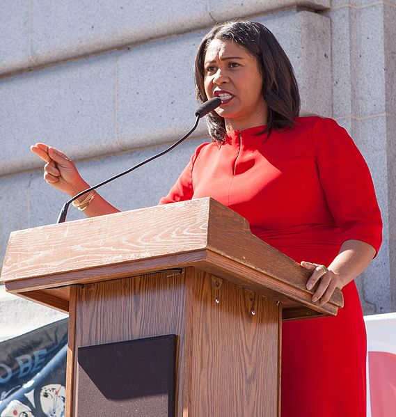 London Breed making a speech on the steps of City Hall.