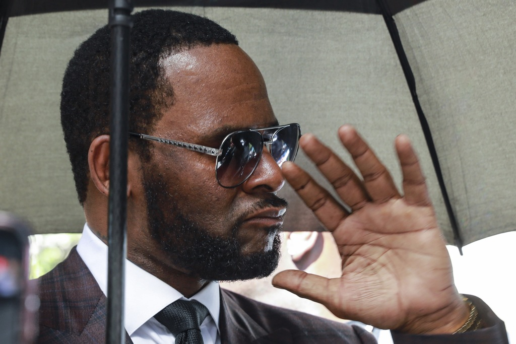 In this June 26, 2019, file photo, Musician R. Kelly departs from the Leighton Criminal Court building after a status hearing in his criminal sexual abuse trial in Chicago.