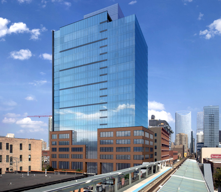 A 20-story rectangular building with a brick base and blue glass top rises near the Morgan CTA station. The Chicago skyline is visible beyond.