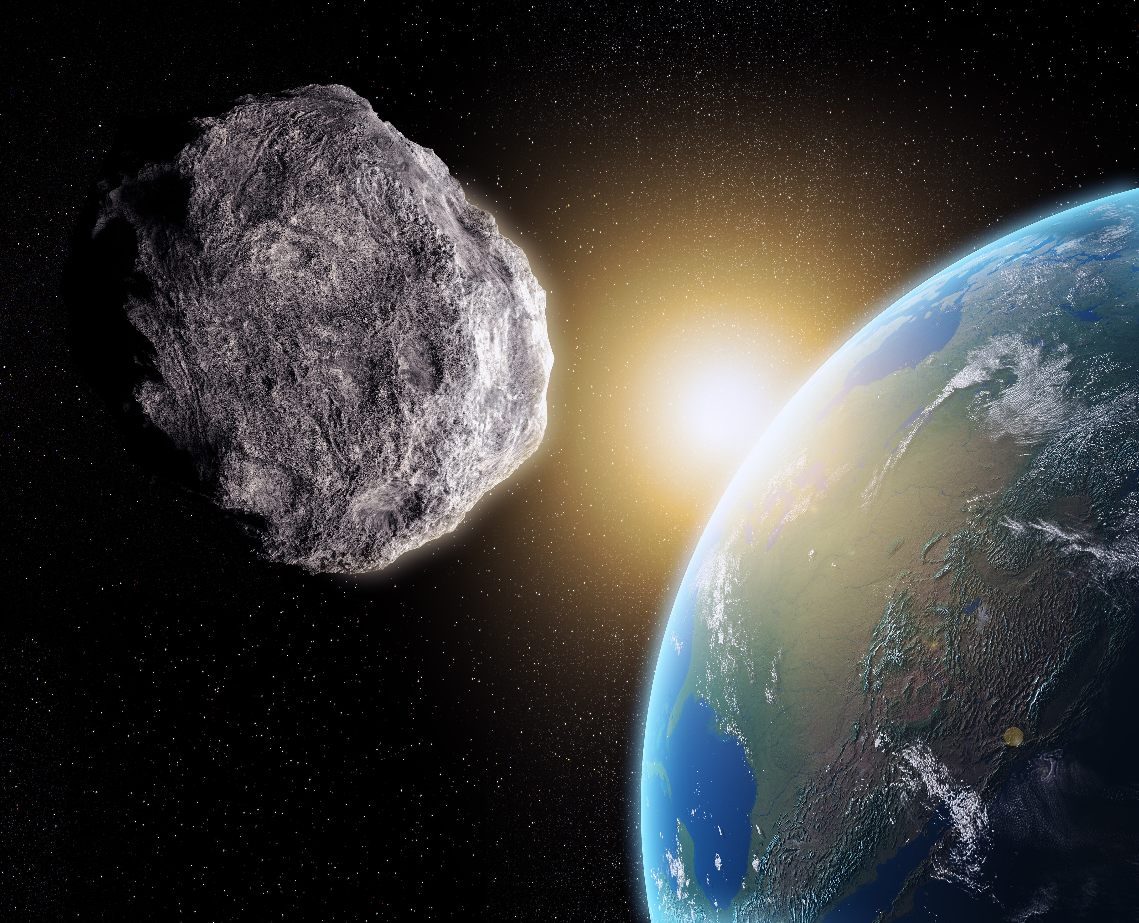An asteroid, with Earth in the background