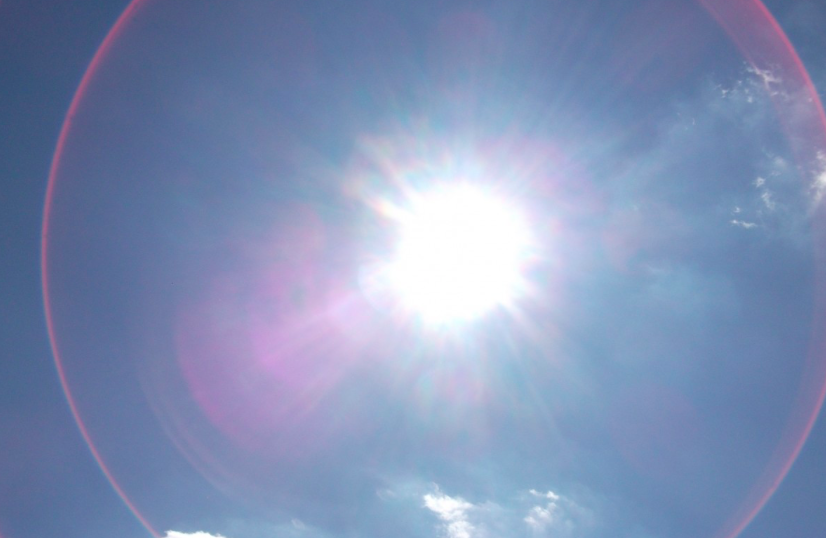 A photo of the sun, surrounded by a single enormous lens flare.