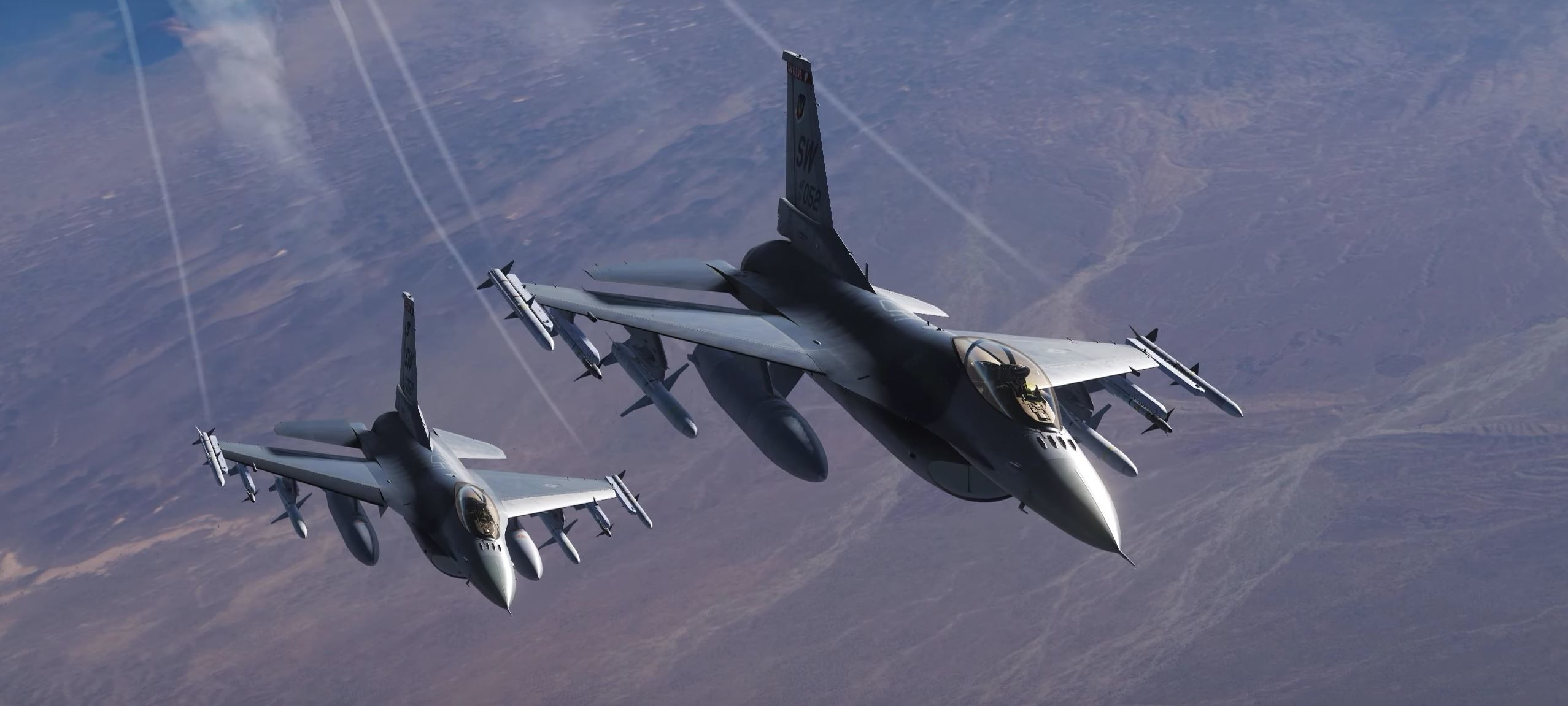 Two F-16C air superiority fighters, with Tactical Air Command tail numbers and chevrons, fly in formation in DCS World.