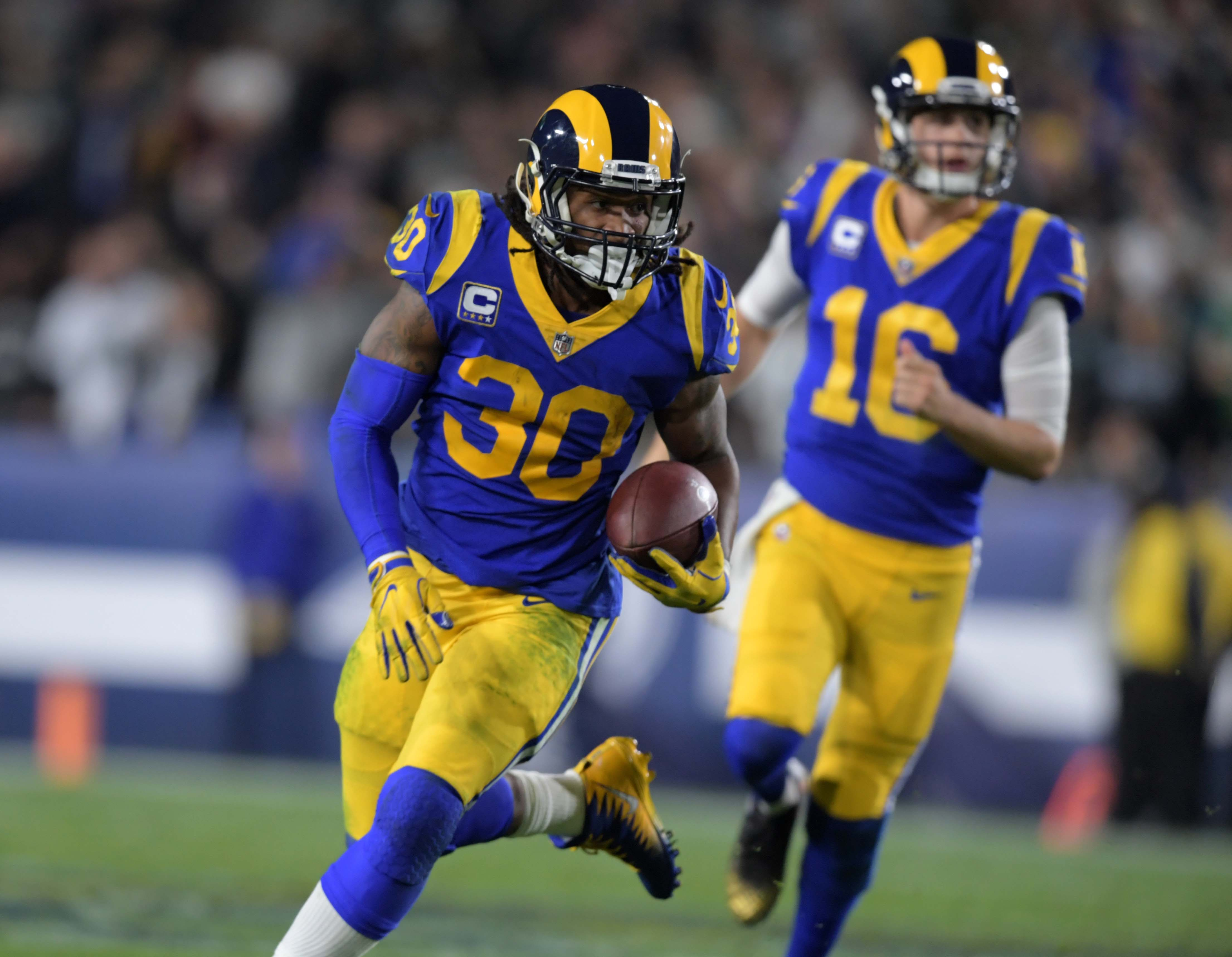 Los Angeles Rams RB Todd Gurley takes a handoff from QB Jared Goff against the Philadelphia Eagles, Dec. 16, 2018.