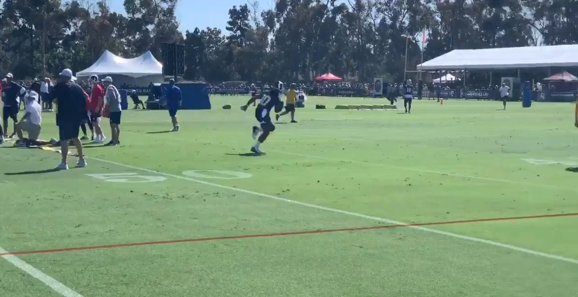 Los Angeles Rams RB Todd Gurley takes a handoff from QB Jared Goff, Jul. 27, 2019.