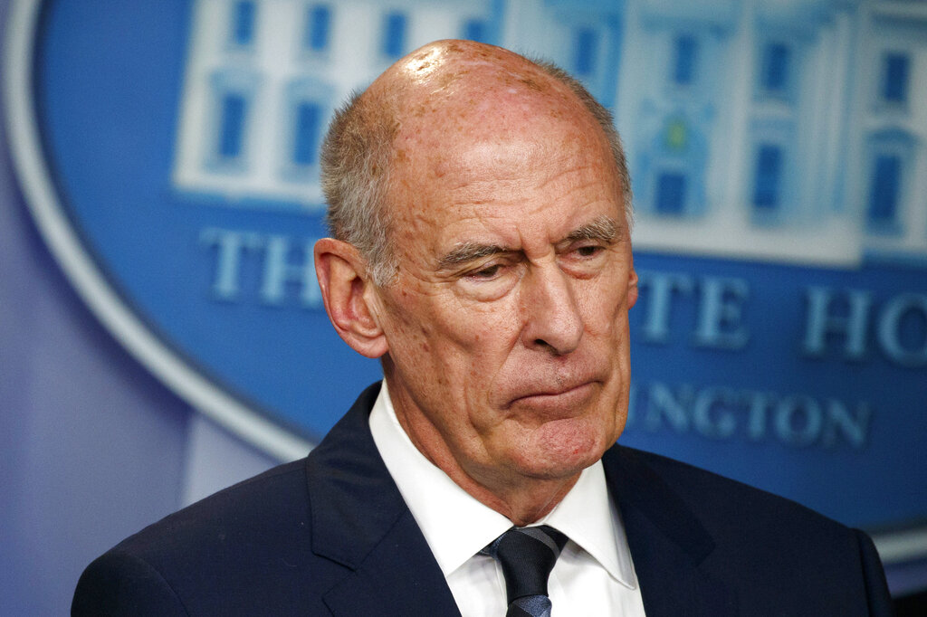 Director of National Intelligence Dan Coats listens during a daily press briefing at the White House in Washington