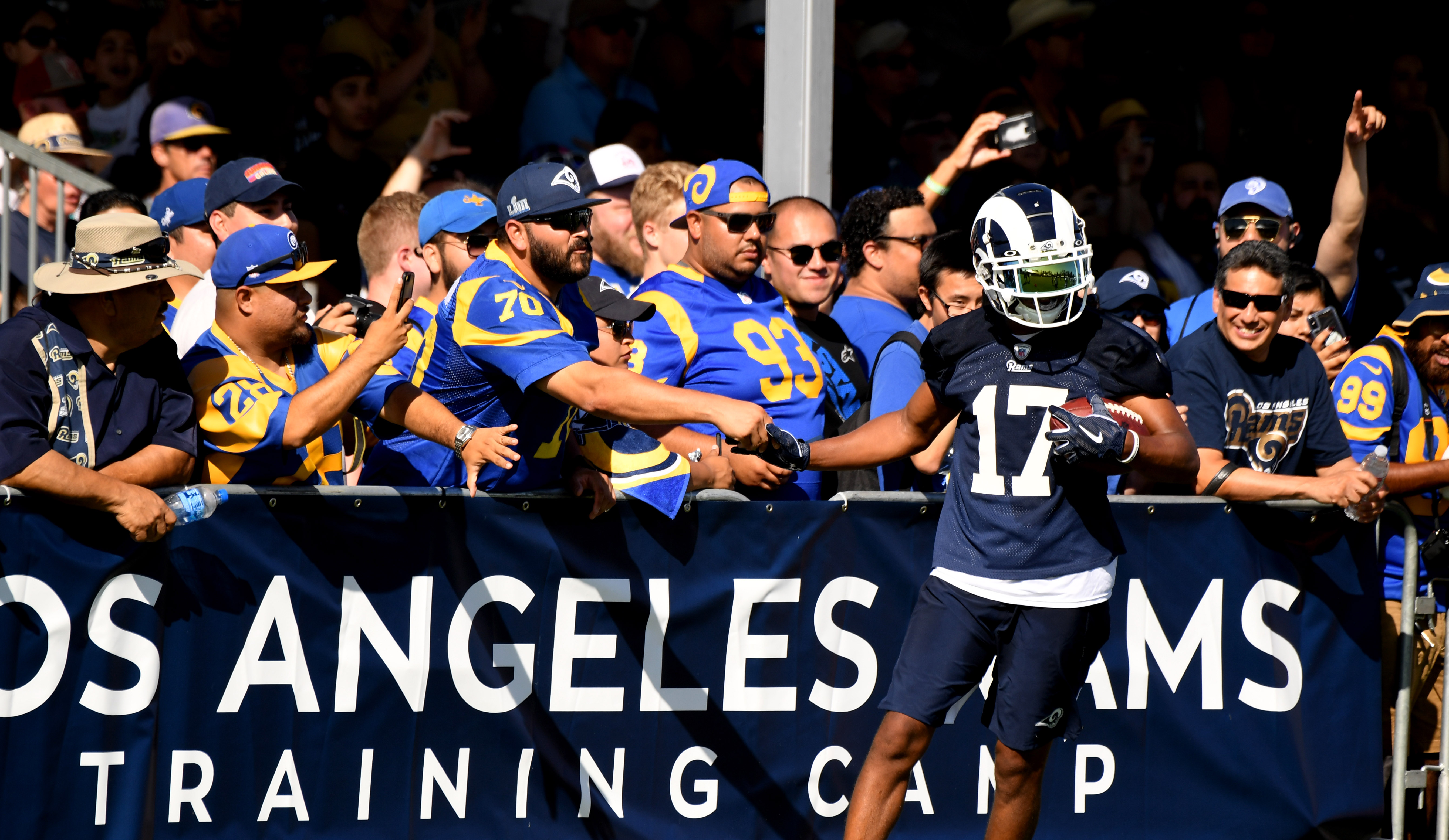 Los Angeles Rams WR Robert Woods high fives fans after a catch during training camp, Jul. 27, 2019.