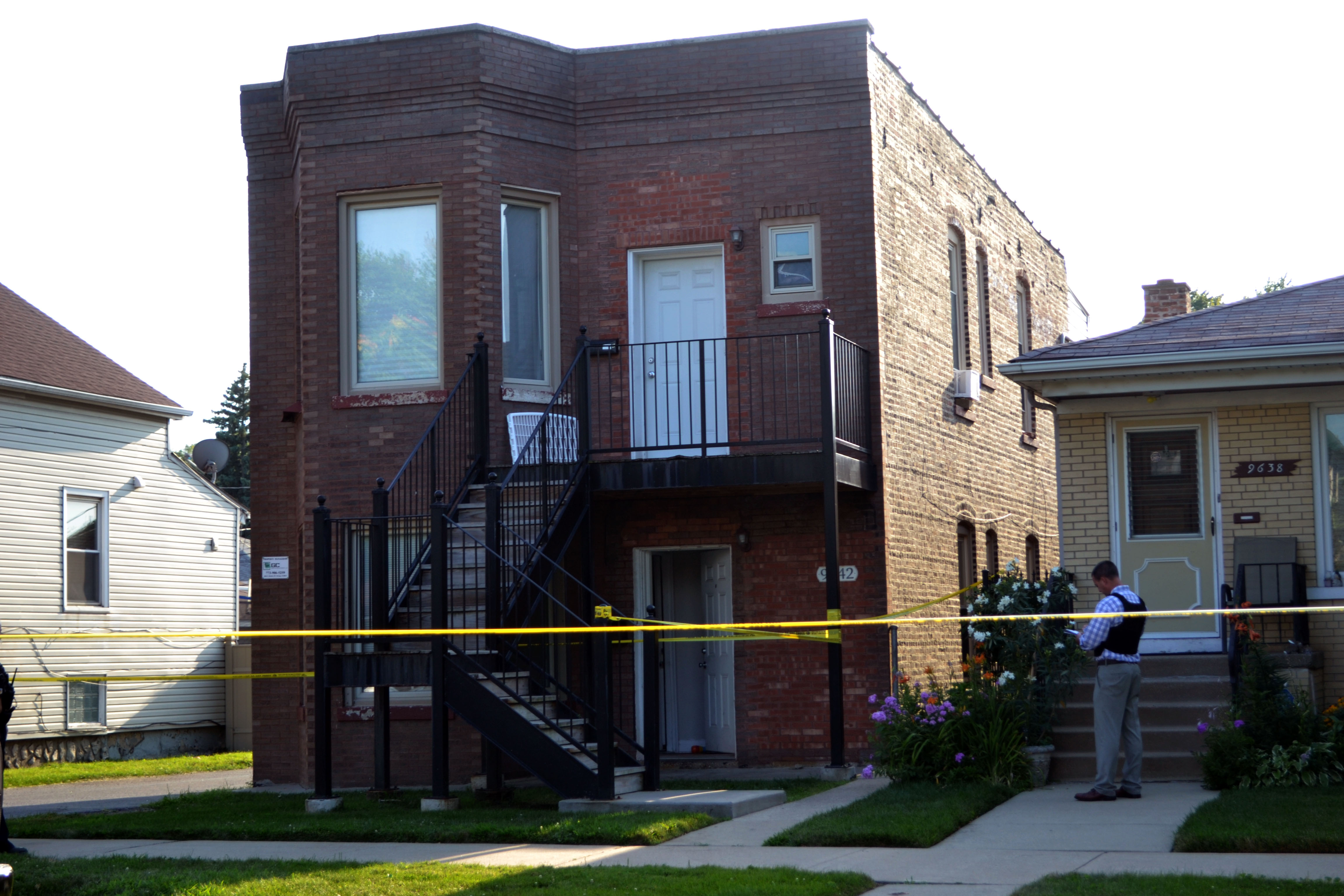 Chicago police investigate the two-story brown brick buidling where a 3 year old child was fatally shot, Sunday afternoon, in the 9600 block of South Escanaba Ave.