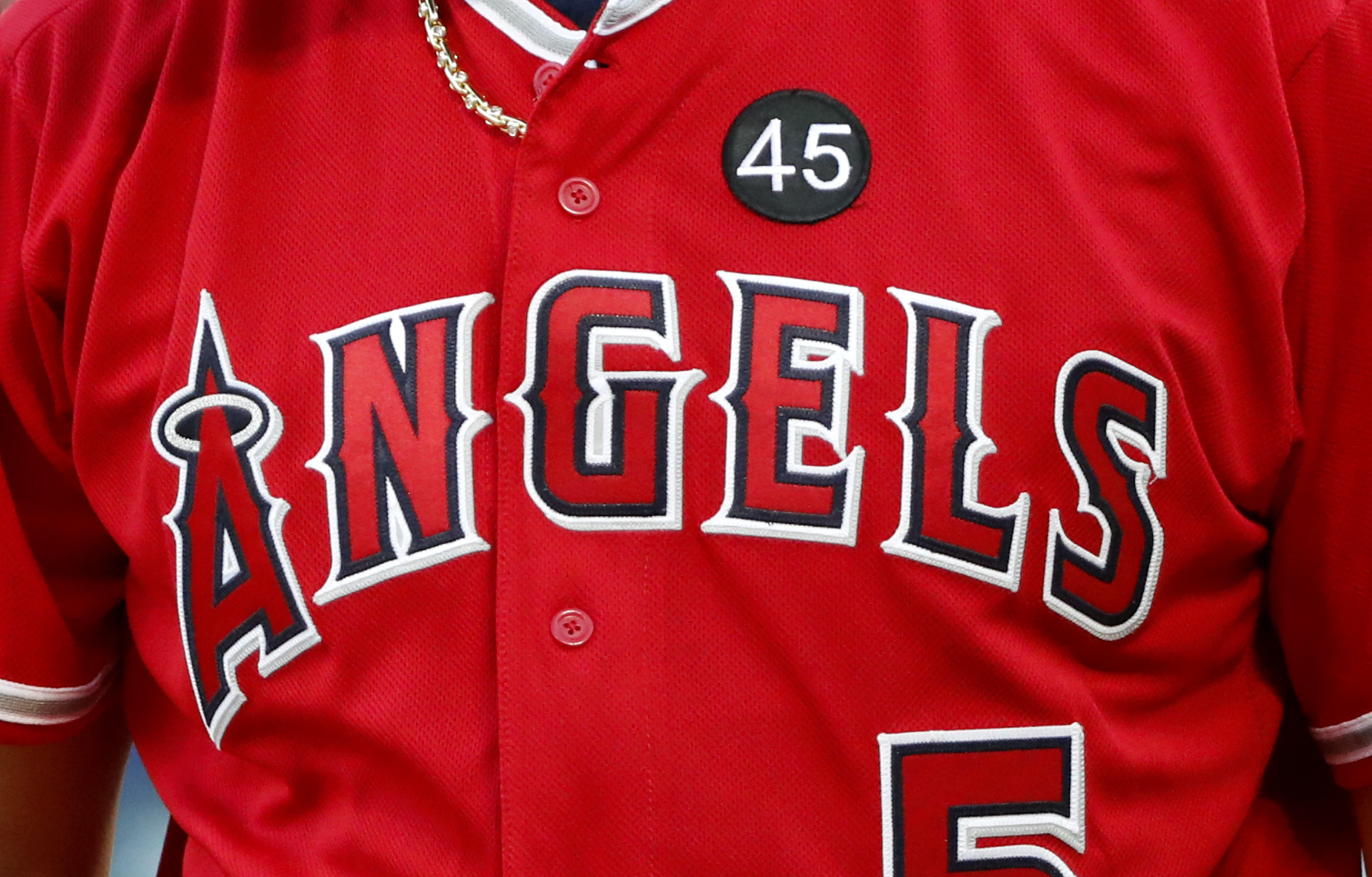 A black patch with the number 45 honoring Tyler Skaggs is seen on the jersey of Albert Pujols during an at-bat in the first inning of a baseball game against the Texas Rangers in Arlington, Texas, Tuesday, July 2, 2019. The entire staff and team wore the