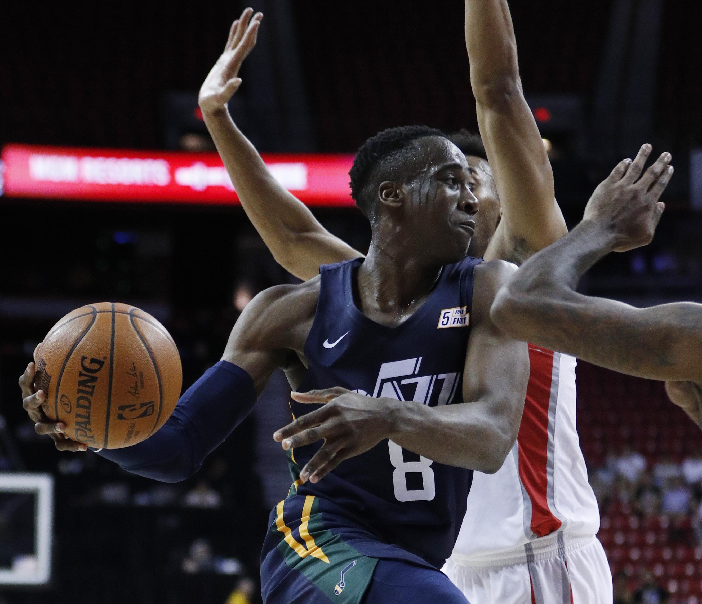 Utah Jazz's Miye Oni drive against the Houston Rockets during the second half of an NBA summer league basketball game Thursday, July 11, 2019, in Las Vegas. (AP Photo/John Locher)