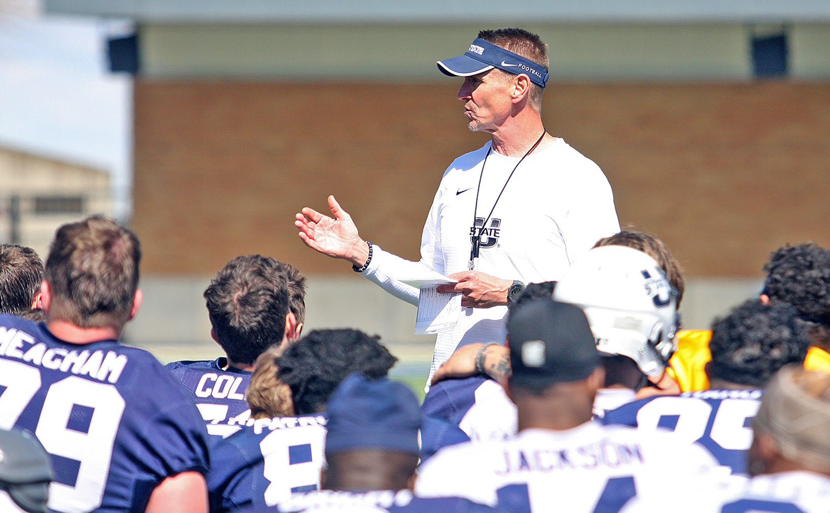 Utah State head football coach Gary Andersen talks to his team at the end of Saturday's scrimmage at Maverik Stadium in Logan.