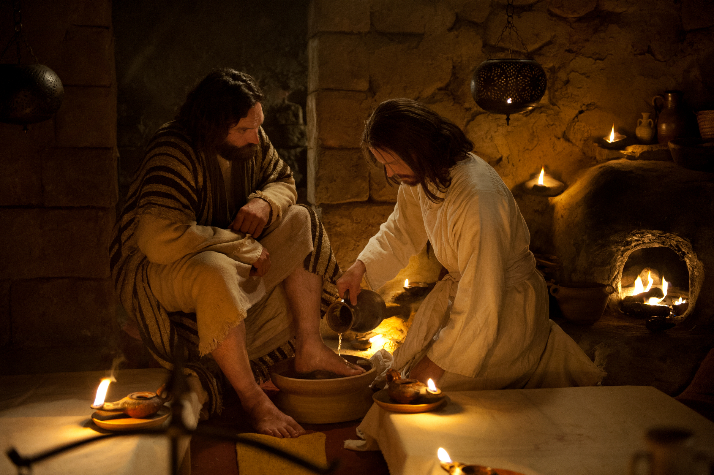 Jesus washes Peter's feet while at the Last Supper with the Apostles in this image from the Bible Videos series.