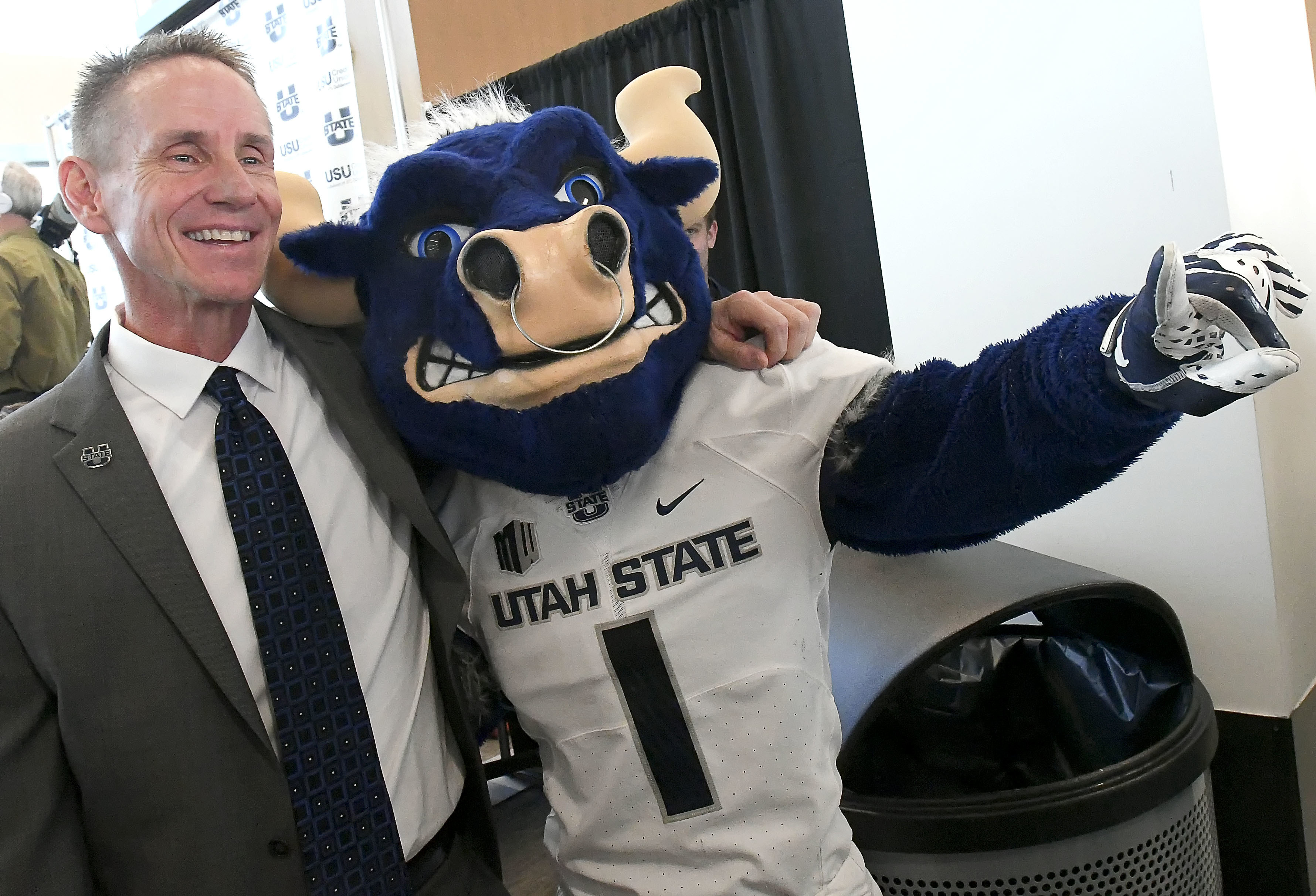 Gary Andersen poses for a photo with Big Blue after speaking at a press conference where he was introduced as the new head football coach at Utah State, Tuesday, Dec. 11, 2018, in Logan, Utah. (Eli Lucero/The Herald Journal via AP)