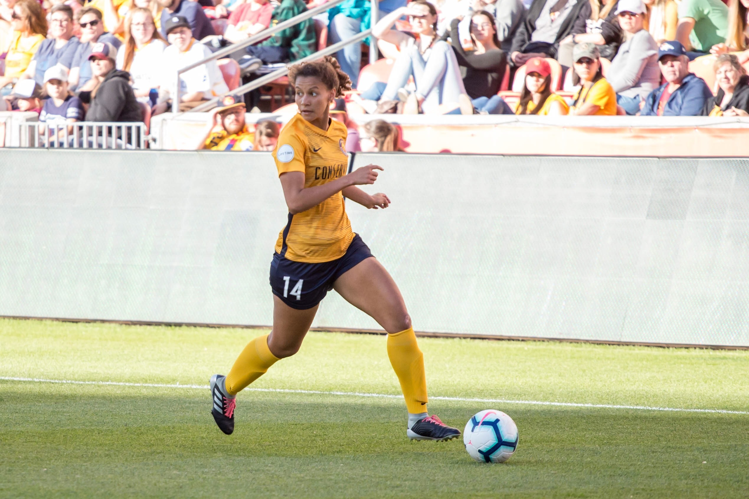 Utah Royals FC rookie center back Gaby Vincent dribbles the ball during a game against the Orlando Pride on May 25, 2019 at Rio Tinto Stadium in Sandy, Utah.
