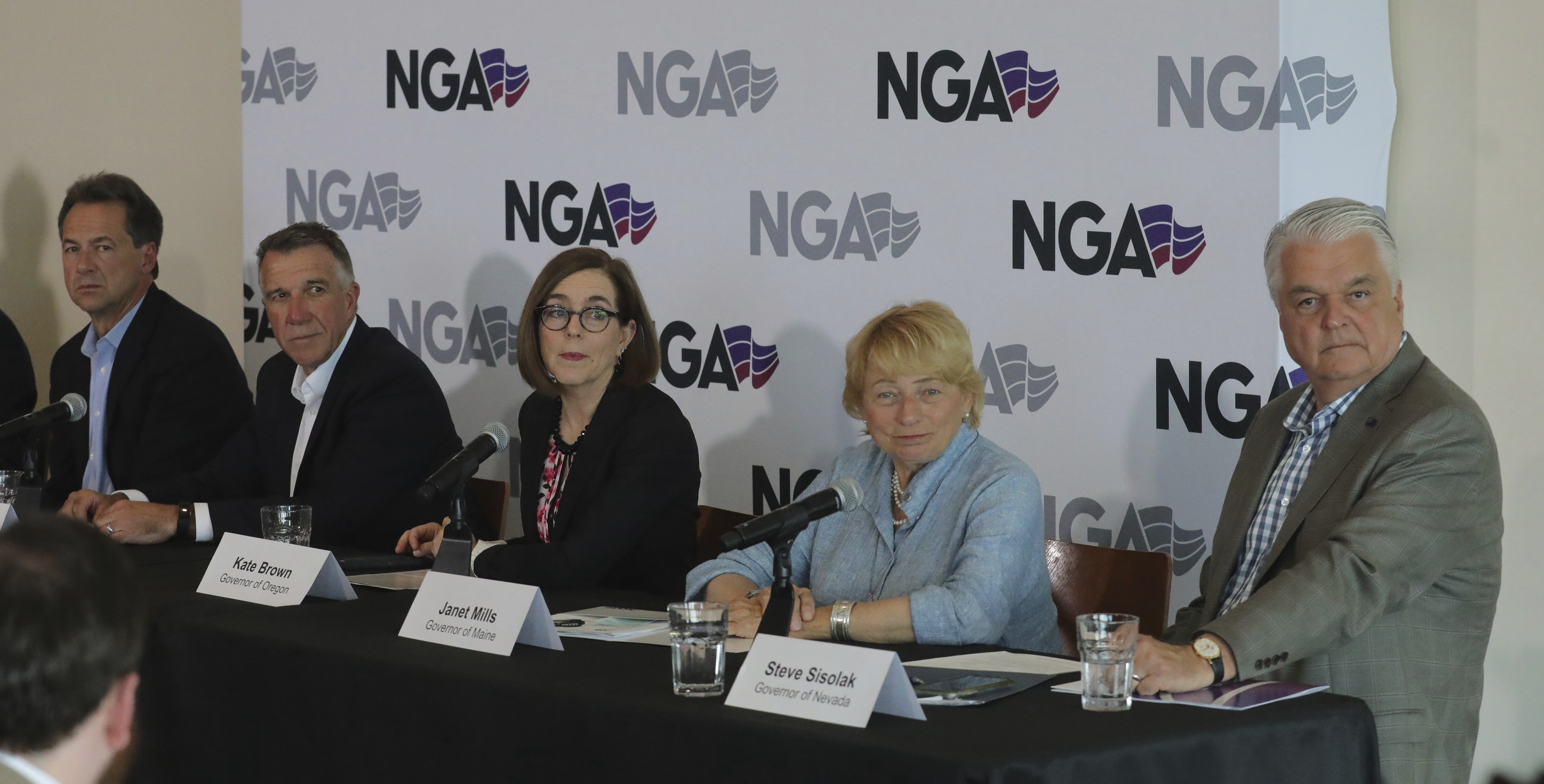 FILE - From left to right, Montana Gov. Steve Bullock, Vermont Gov. Phil Scott, Oregon Gov. Kate Brown, Maine Gov. Janet Mills and Nevada Gov. Steve Sisolak look on during a news conference launching an Outdoors Recreation Initiative Wednesday, July 24, 2
