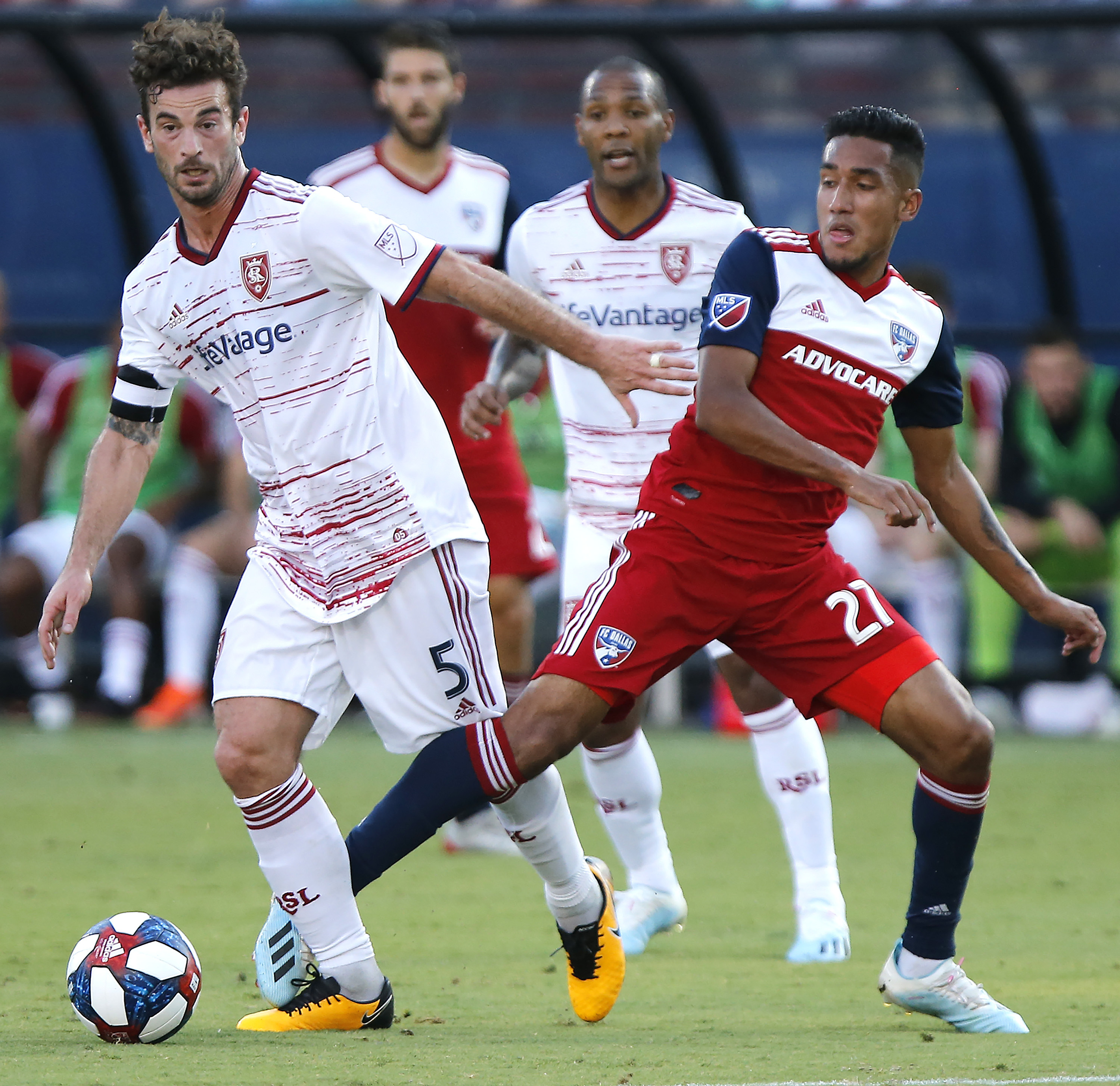 FC Dallas forward Jesus Ferreira (27) and Real Salt Lake midfielder Kyle Beckerman (5) become entangled during the first half of an MLS soccer match in Frisco, Texas, Saturday, July 27, 2019. (Stewart F. House/The Dallas Morning News via AP)