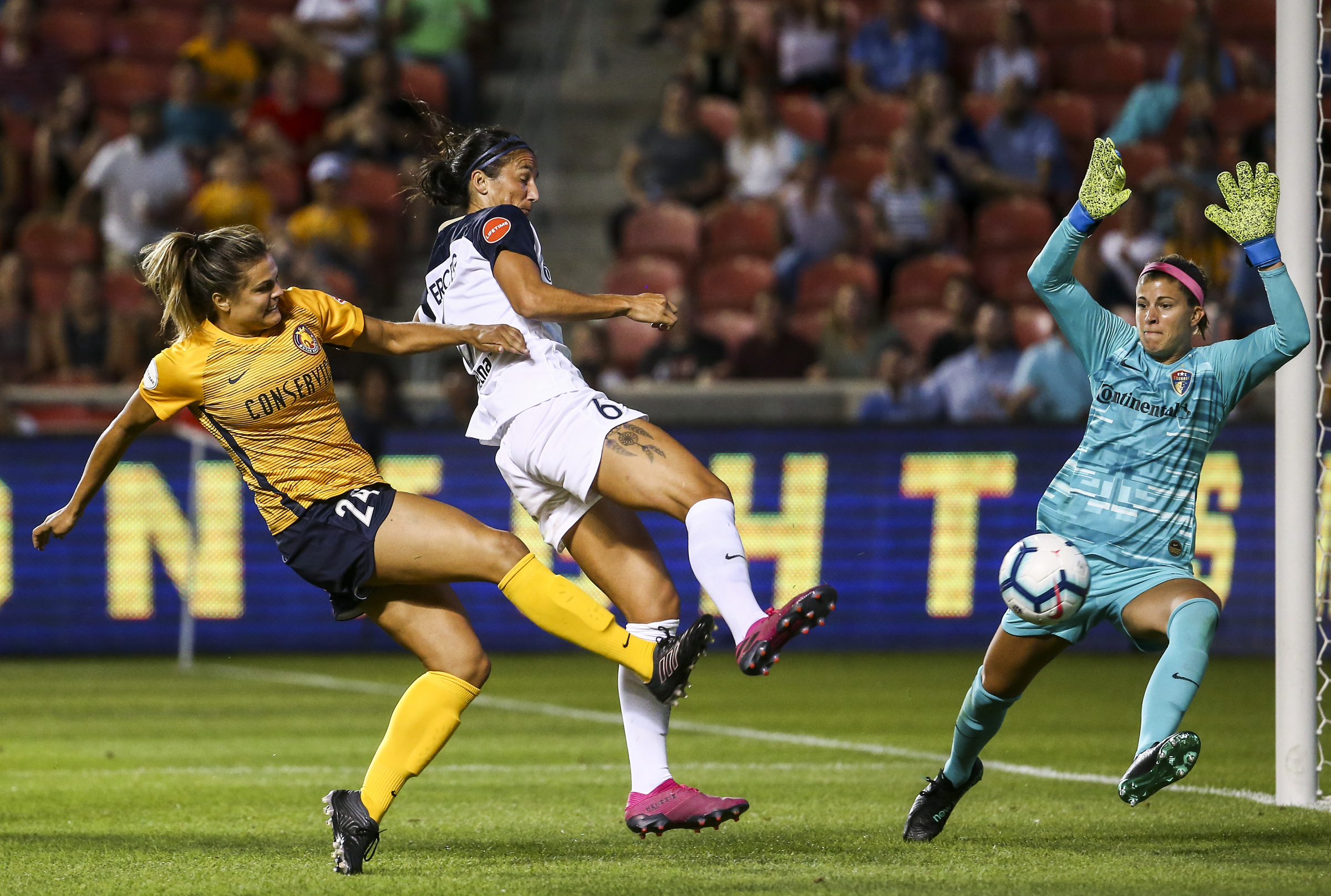 Utah Royals FC forward Katie Stengel (24) takes a shot around North Carolina Courage defender Abby Erceg (6) that is blocked by goalkeeper Stephanie Labbé (1) during the second half of a National Women's Soccer League match at Rio Tinto Stadium in Sandy o