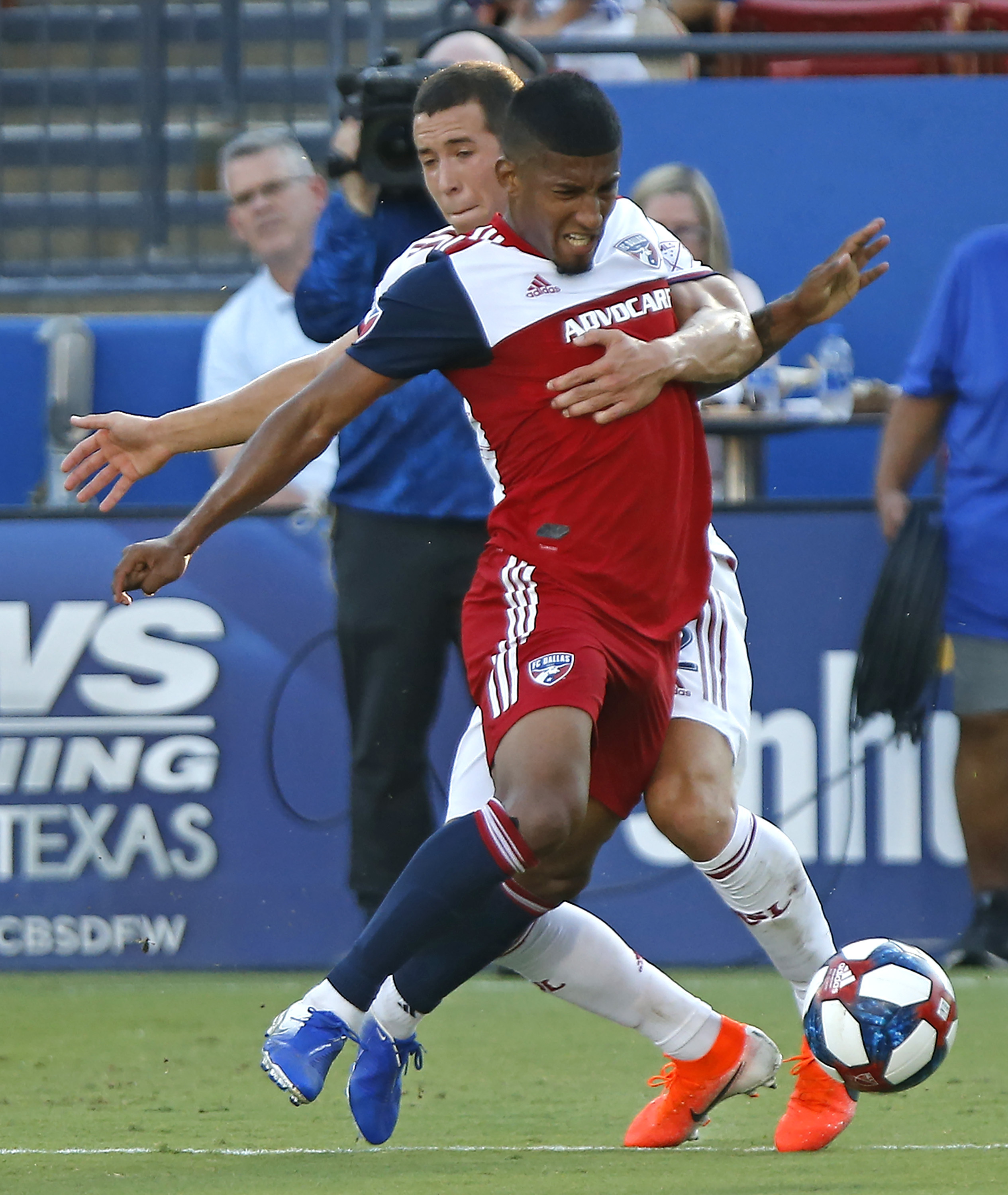 FC Dallas midfielder Santiago Mosquera, front, is held up by Real Salt Lake defender Aaron Herrera (22) during the first half of an MLS soccer match in Frisco, Texas, Saturday, July 27, 2019. (Stewart F. House/The Dallas Morning News via AP)