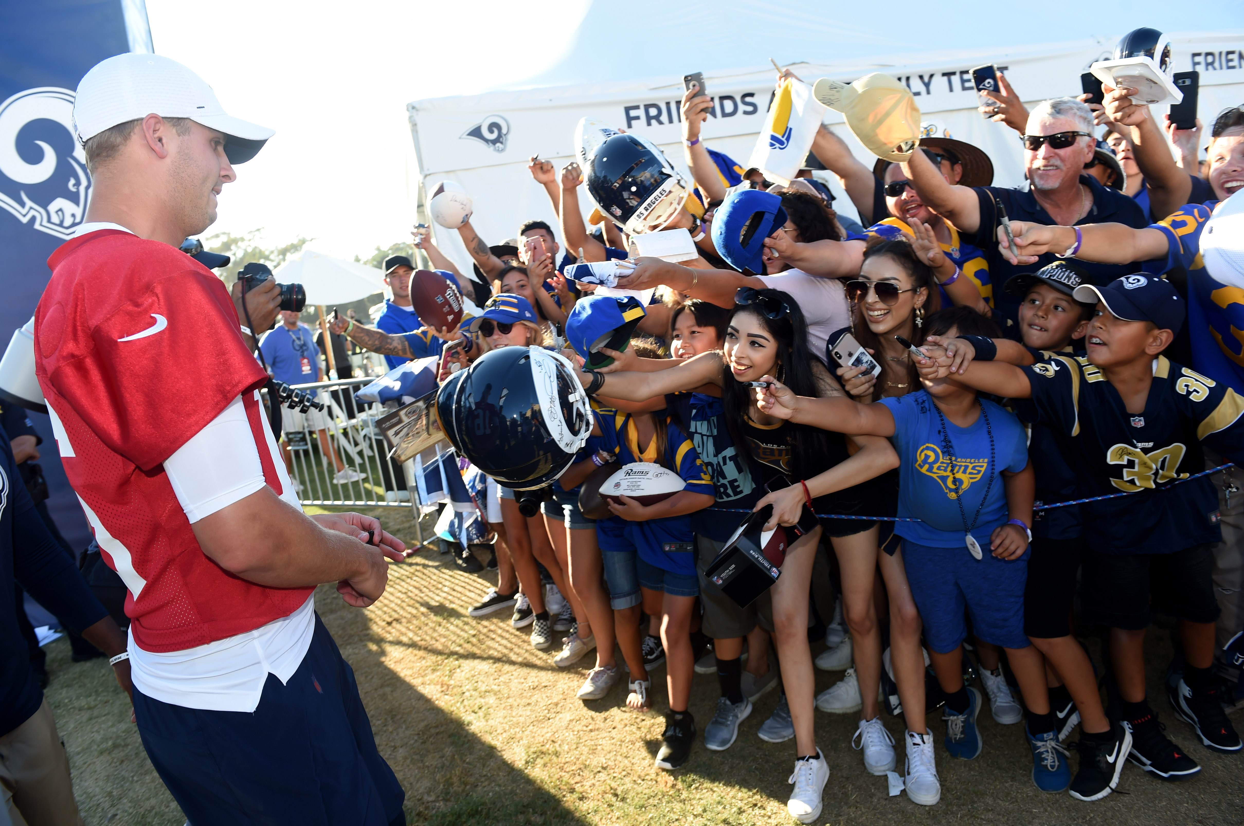 Los Angeles Rams QB Jared Goff signs autograph after practice during training camp, Jul. 27, 2019.