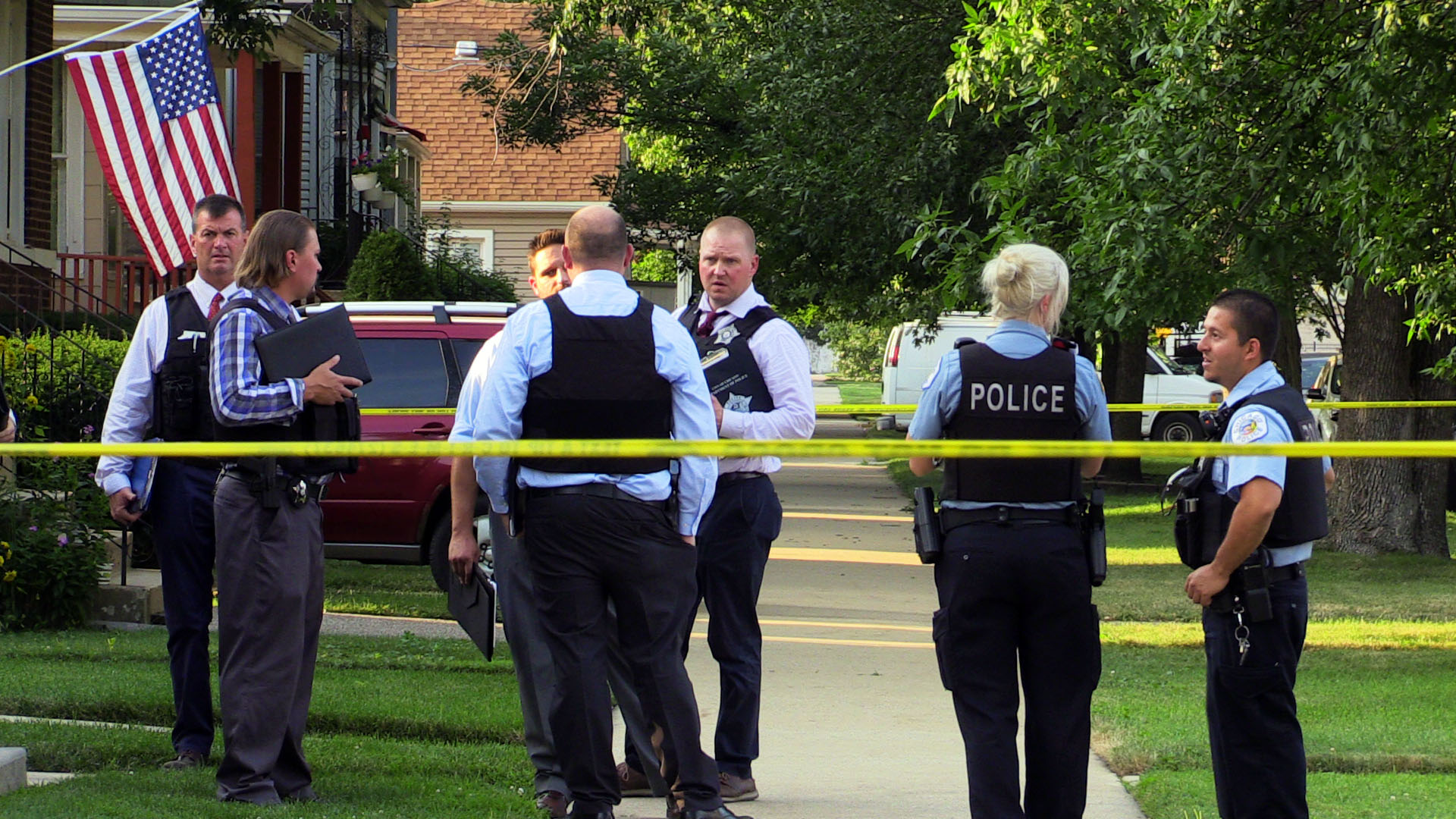 Chicago police investigate the scene where a 3 year old child was fatally shot, Sunday afternoon, in the 9600 block of South Escanaba Ave., in South Deering.