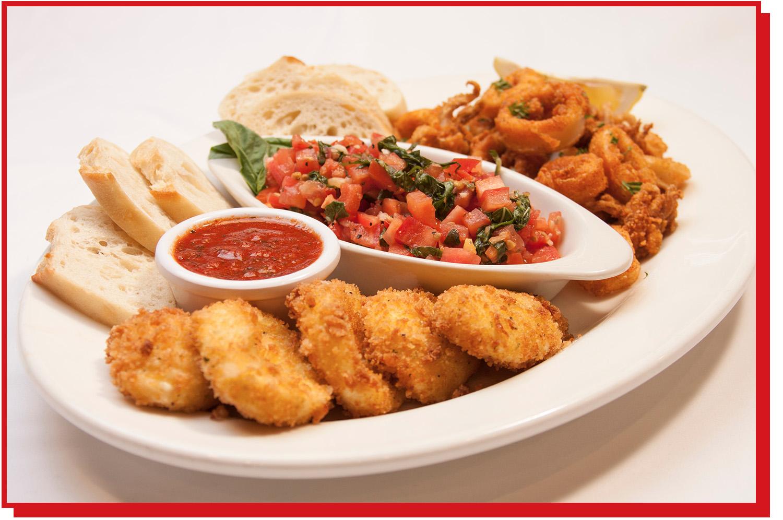 An appetizer sampler with calamari, bruschetta, and deep-fried mozzarella