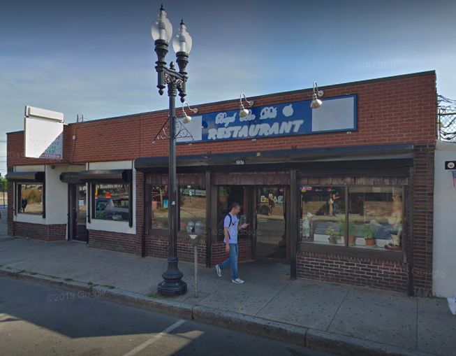 An exterior photo shows the brick building housing Bagel Bin Deli in Revere