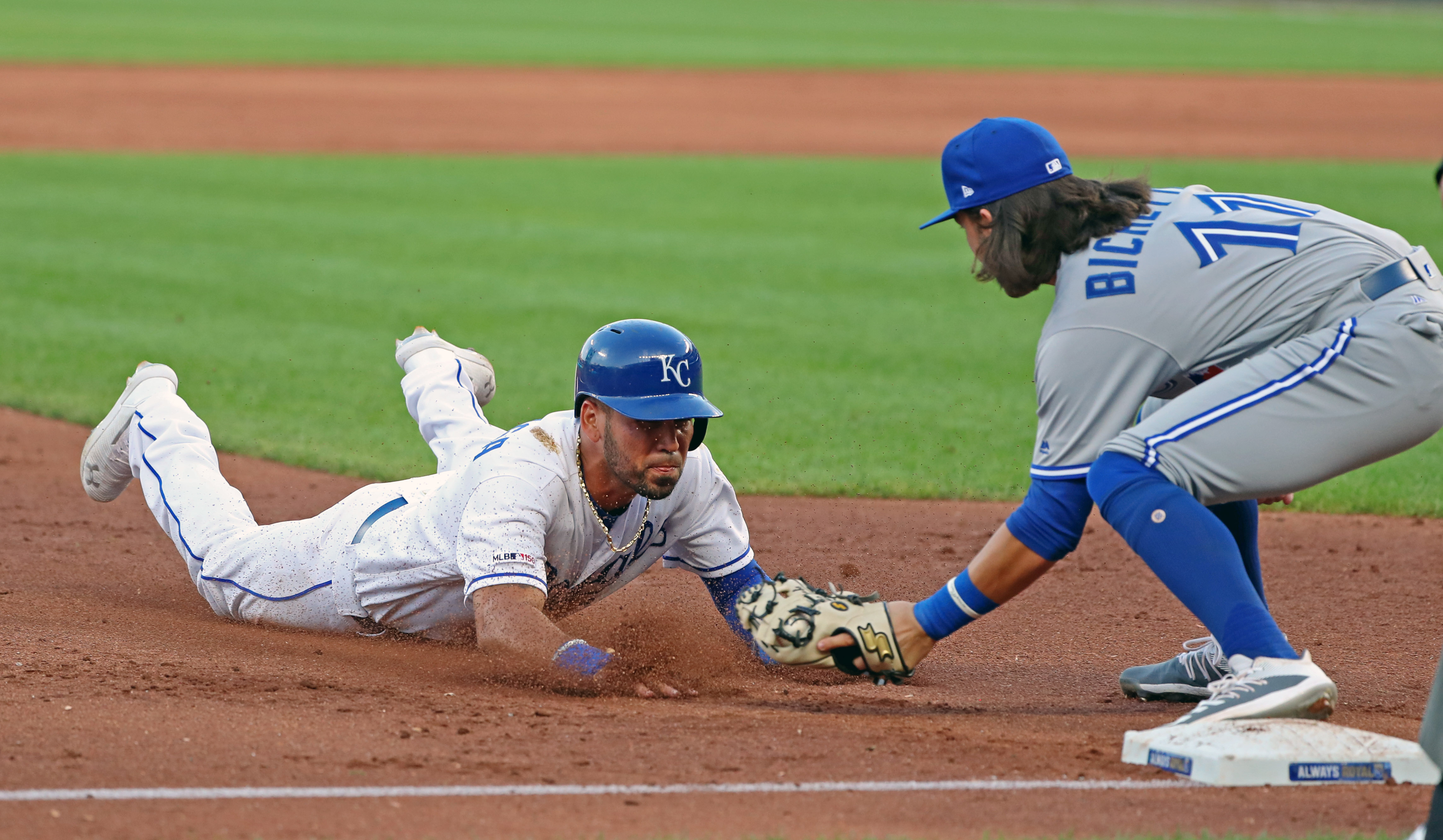 Kansas City Royals shortstop Humbeto Arteaga (2) is tagged out at third base by Toronto Blue Jays shortstop Bo Bichette (11) during the second inning at Kauffman Stadium.