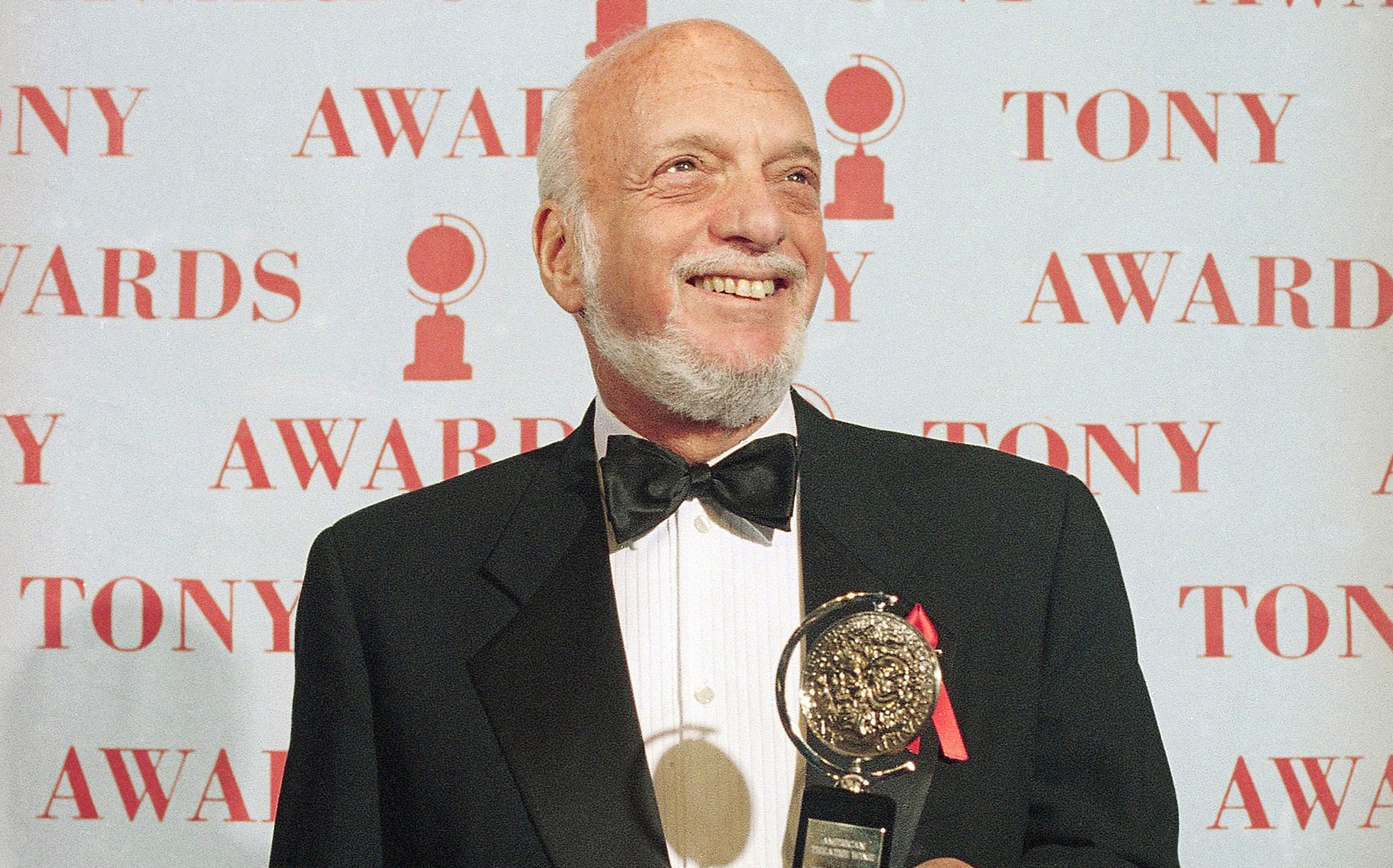 "In this 1995 file photo, Harold Prince holds his Tony award for best director in a musical for ""Show Boat."""