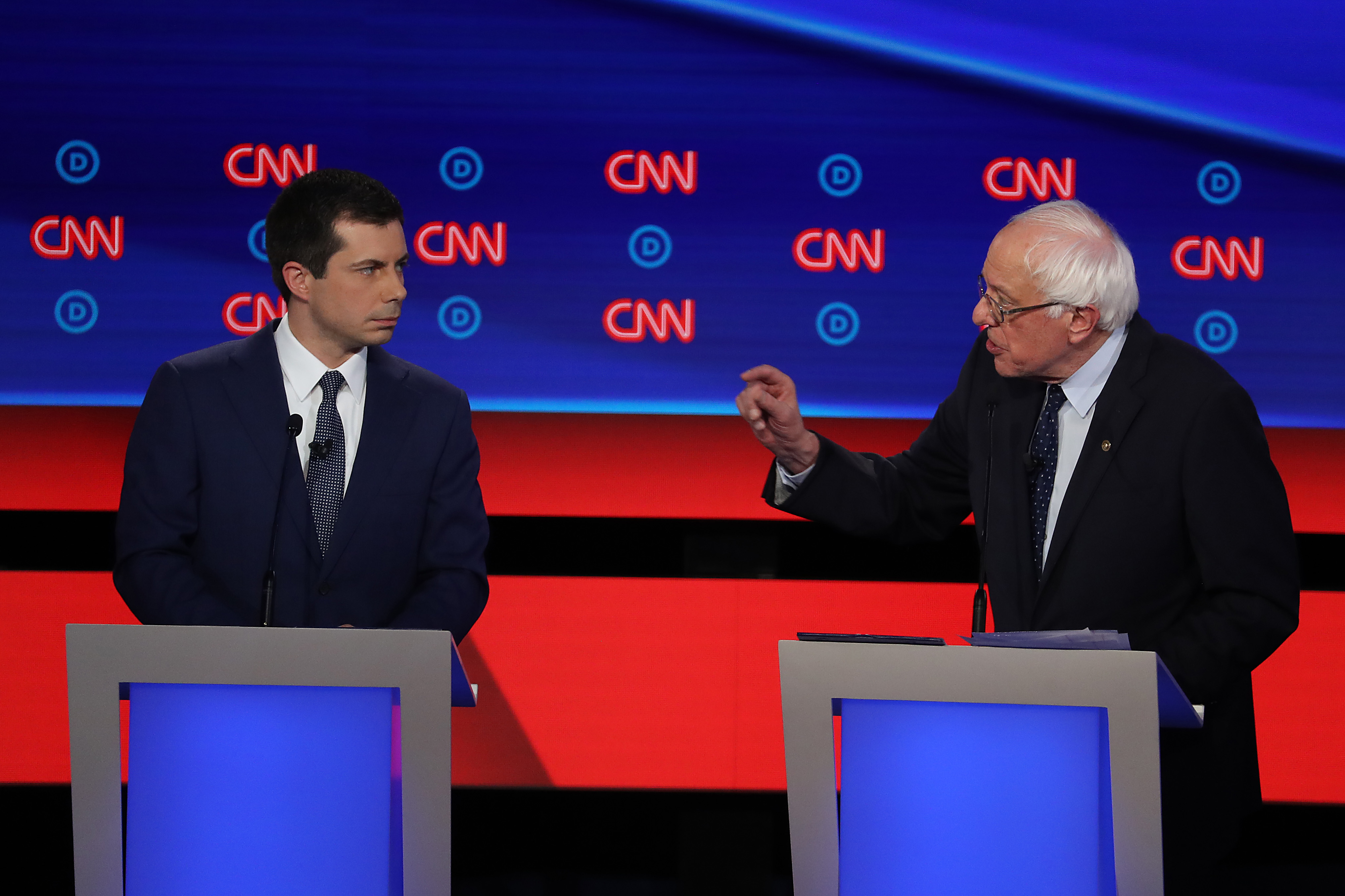 Democratic presidential candidate Sen. Bernie Sanders (I-VT) (R) speaks while South Bend, Indiana Mayor Pete Buttigieg listens during the Democratic Presidential Debate at the Fox Theatre July 30, 2019 in Detroit, Michigan.