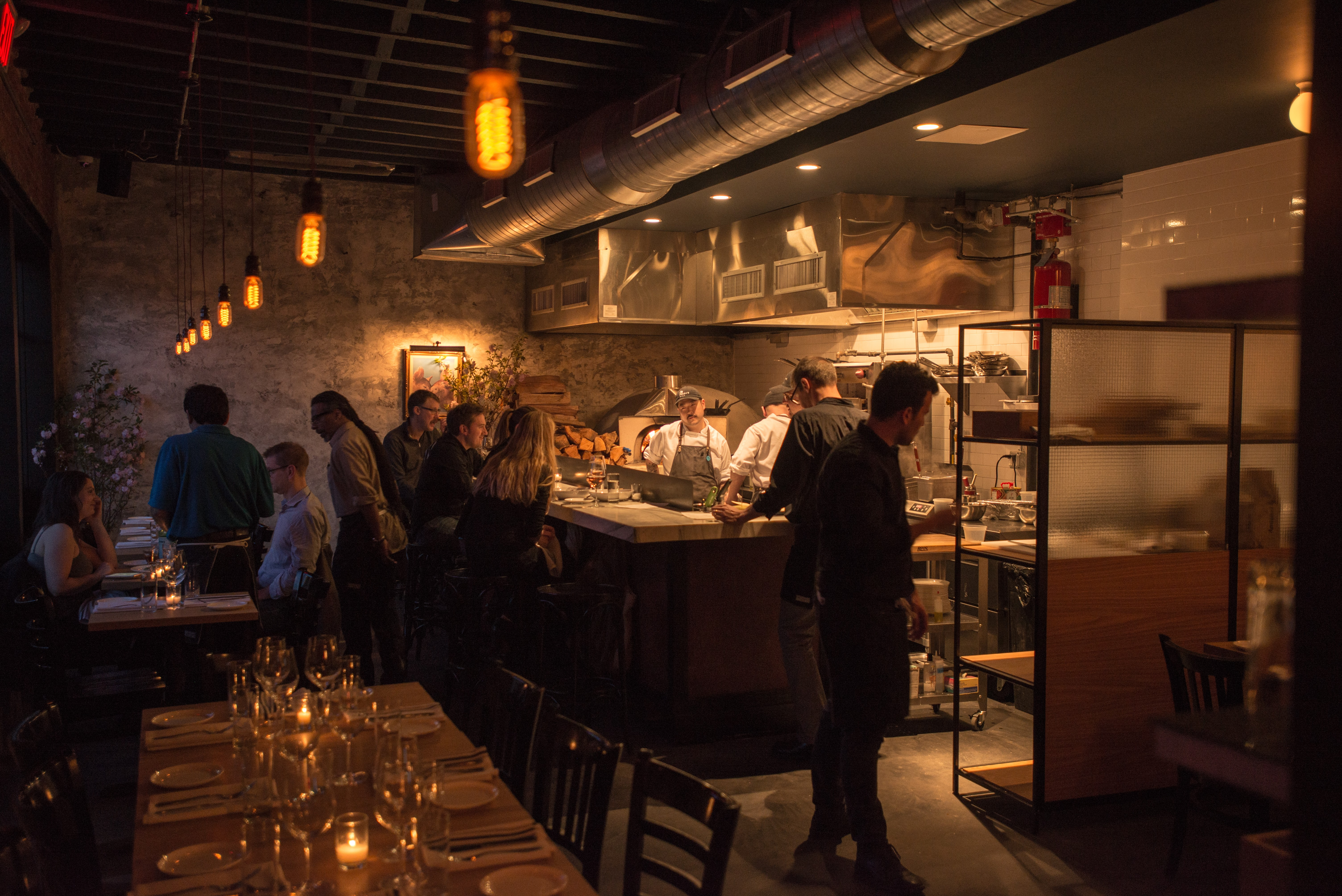 The dark, warm interior of Freek's Mill, with a wood-fire oven burning in the back