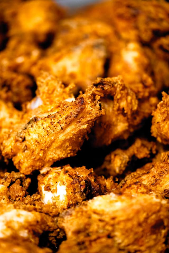 A closeup shot of pieces of fried chicken