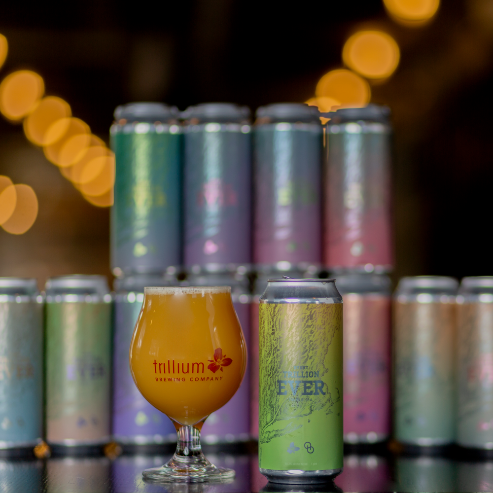 A glass and cans of Trillium beer Every Trillion Ever