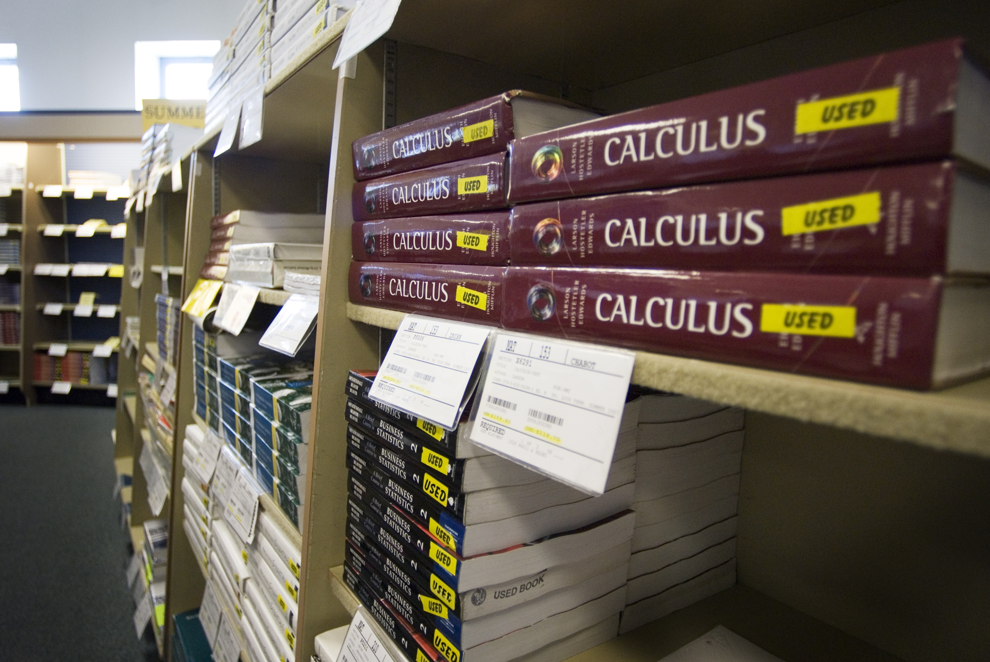 Calculus textbooks on a university bookstore shelf