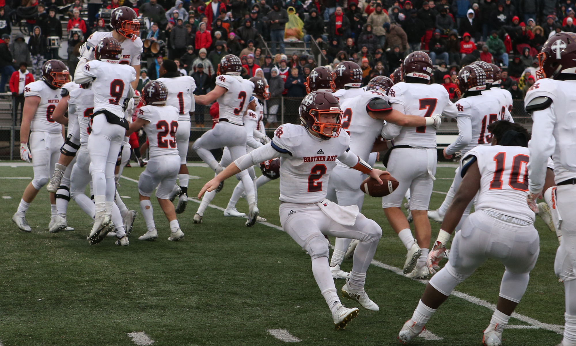 Brother Rice's John Bean (2) and his teammates celebrate after their 14-3 semifinal victory over Marist.