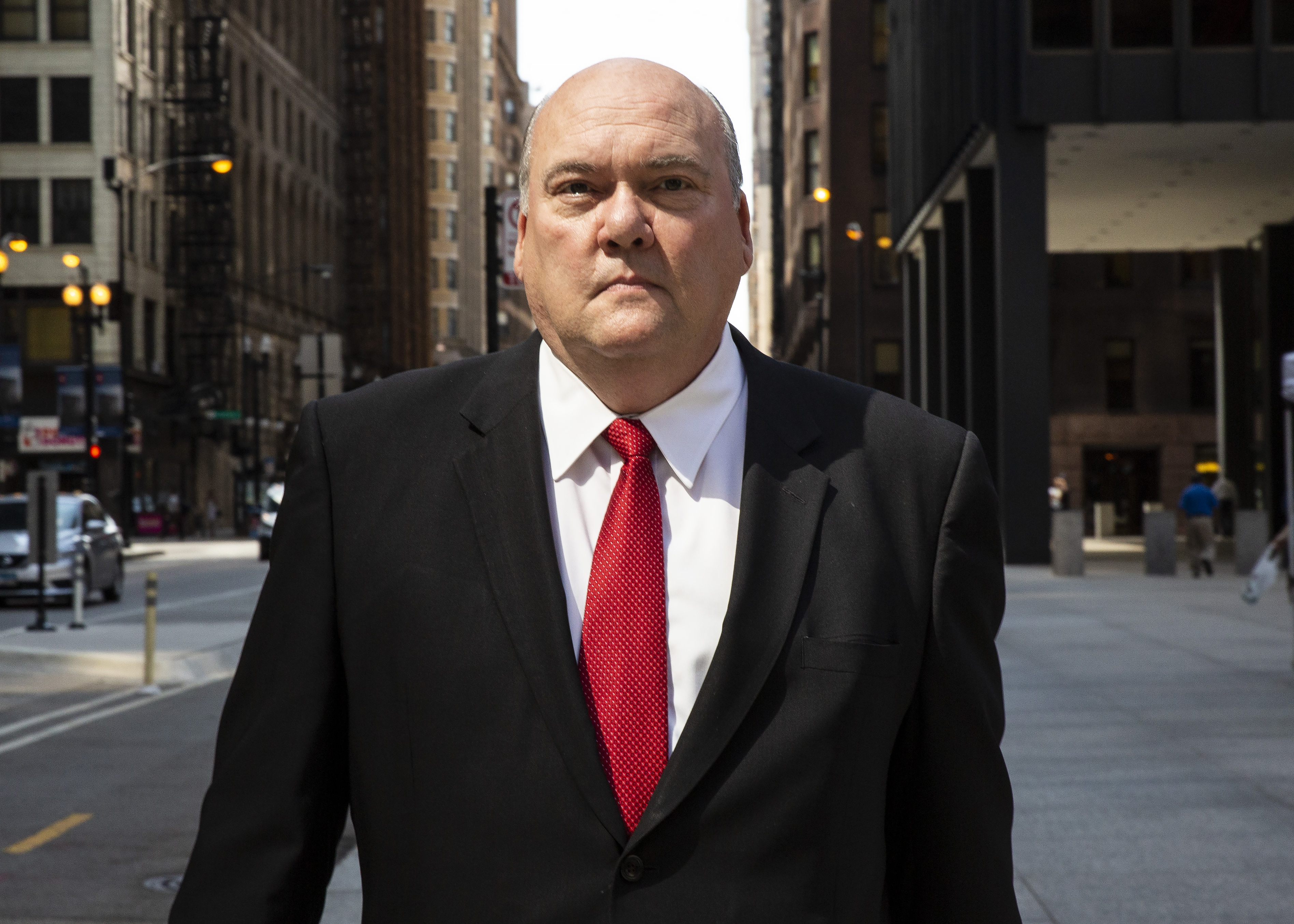 Former longtime Chicago Teamsters union boss John T. Coli Sr. leaving court after pleading guilty to taking part in a scheme to shake down a Chicago film studio.