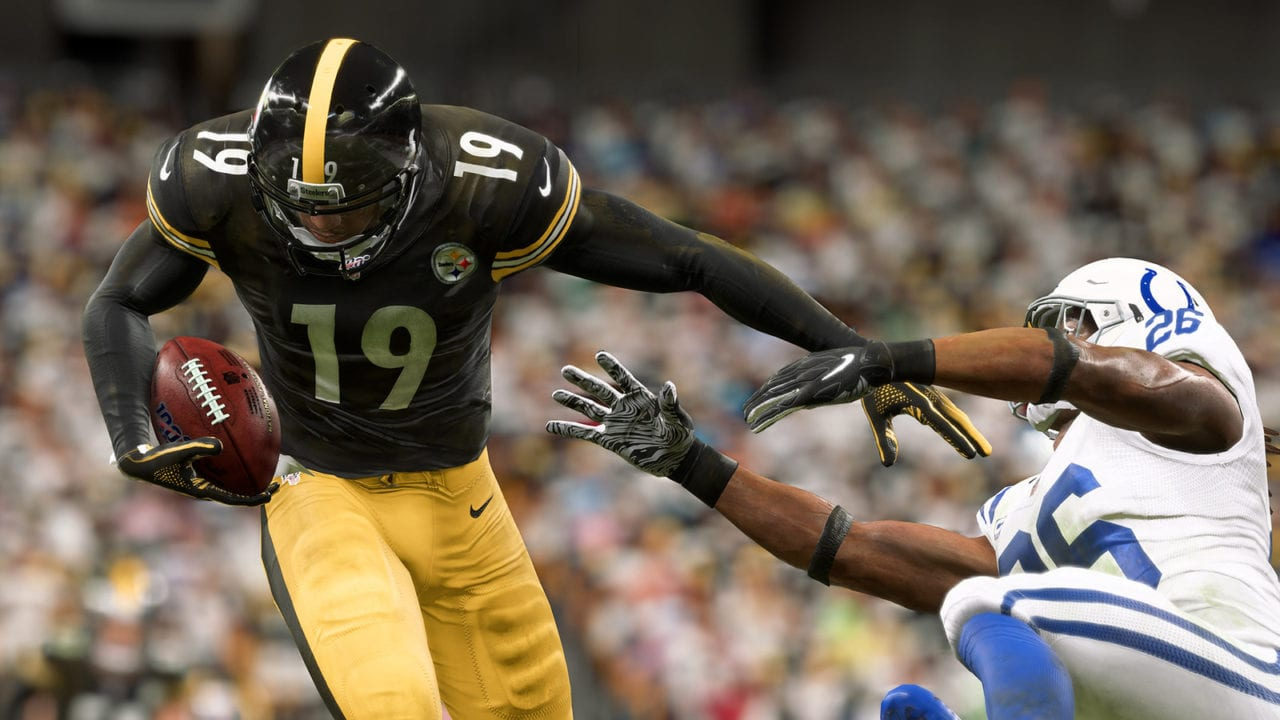 Screenshot of Madden NFL 20, in which Steelers receiver JuJu Smith-Schuster is stiff-arming a defender for the Indianapolis Colts.