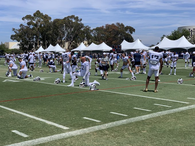 The Los Angeles Rams warm up for a training camp practice with the Los Angeles Chargers, Aug. 3, 2019.