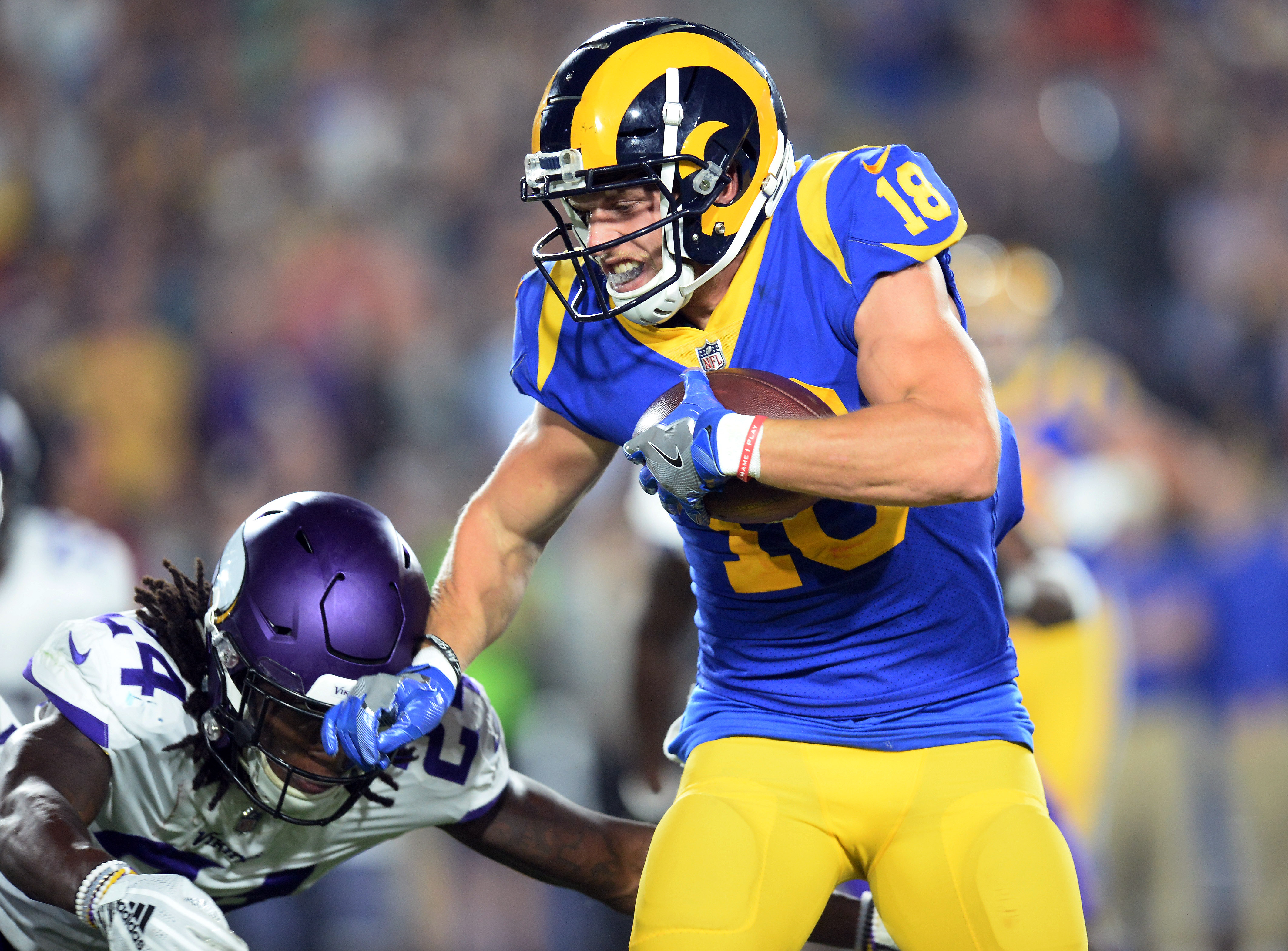 Los Angeles Rams WR Cooper Kupp runs through a tackle attempt from Minnesota Vikings CB Holton Hill, Sep. 27, 2018.