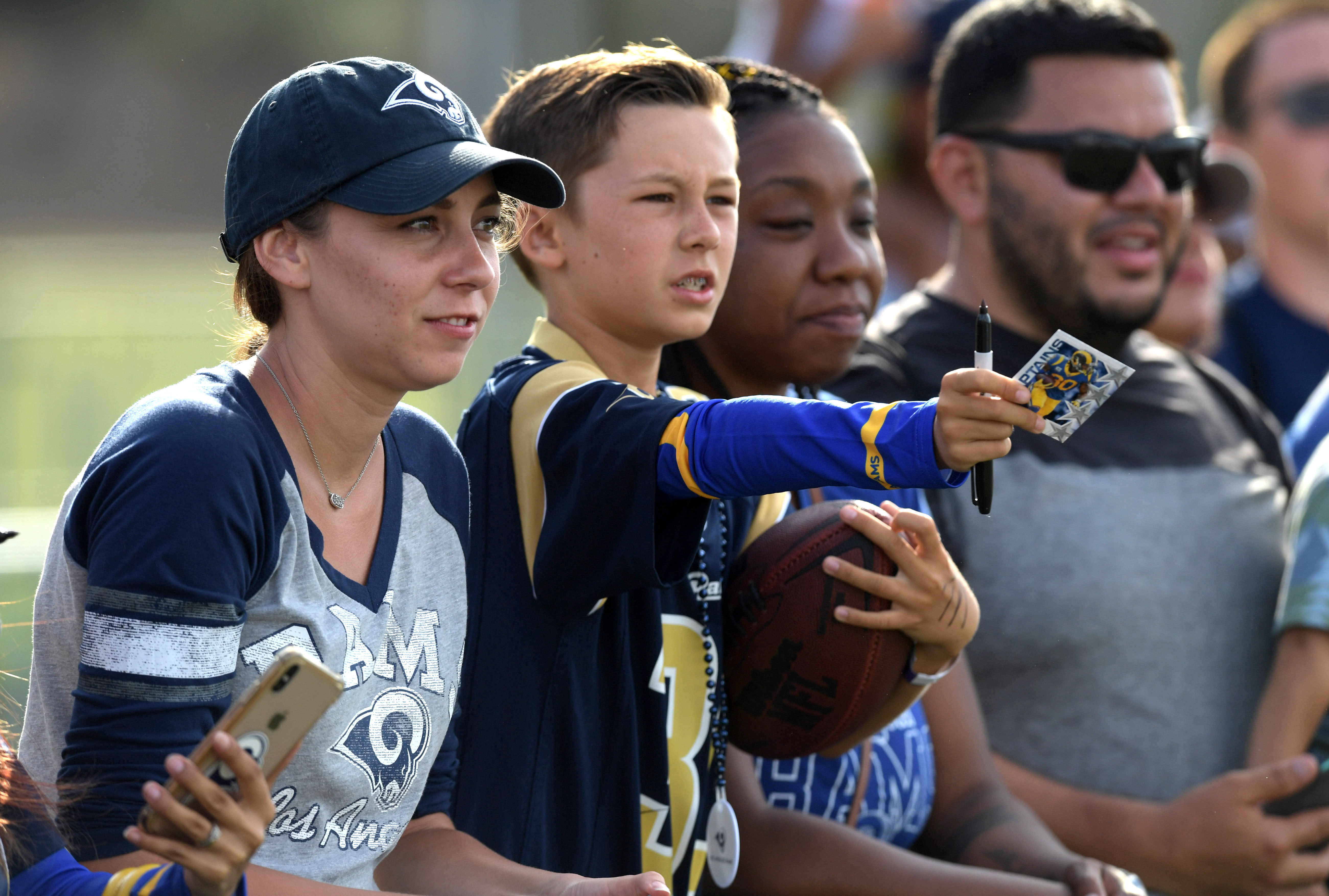 Los Angeles Rams fans wait for autographs during training camp at UC Irvine, Jul. 30, 2019.