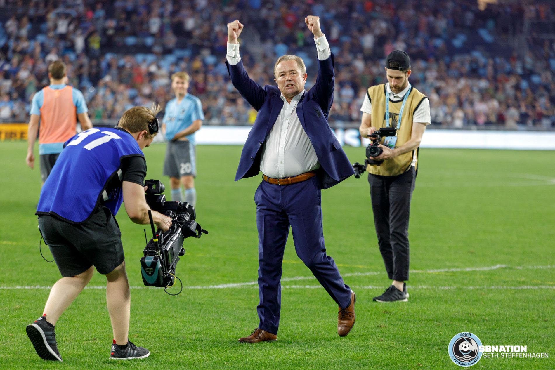 July 13, 2019 - Saint Paul, Minnesota, United States - Minnesota United head coach Adrian Heath walks over to the Wonderwall to celebrate the 1-0 victory over FC Dallas at Allianz Field.