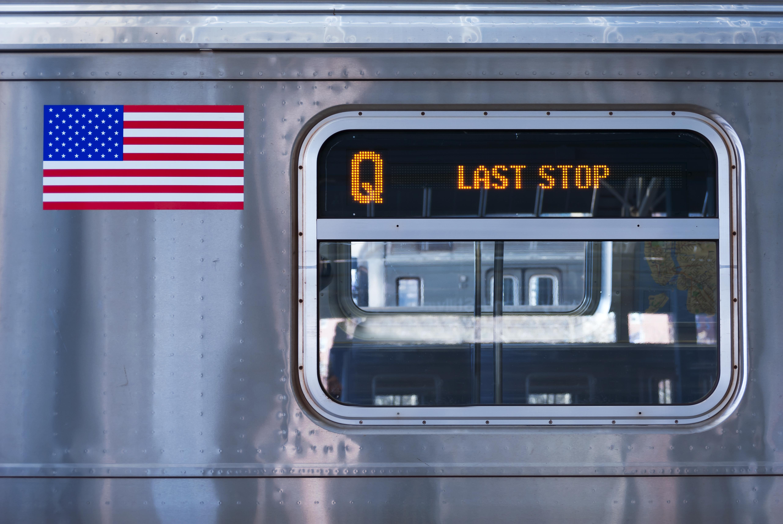 A Q train arrives at a subway station.