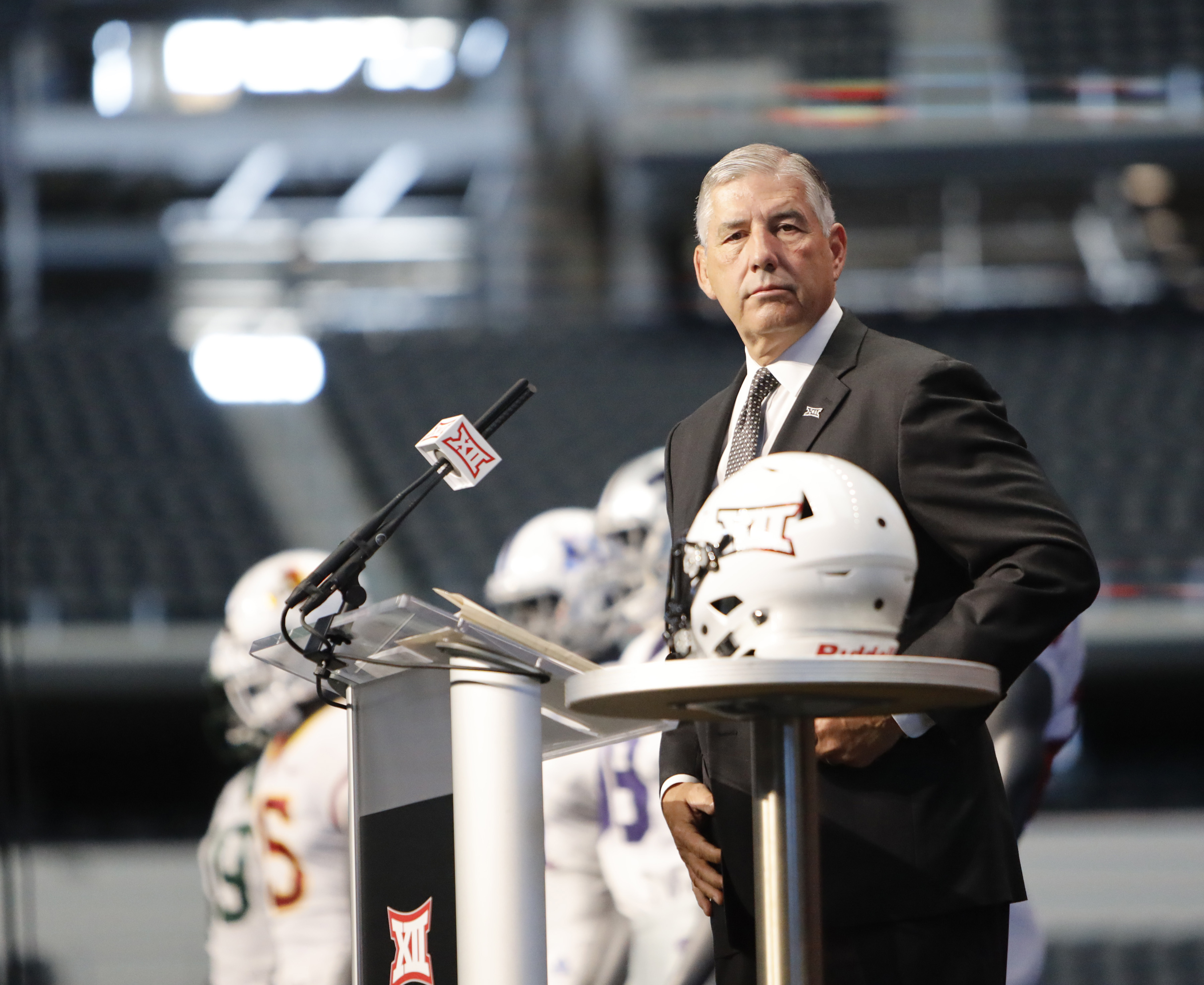 Big 12 Conference commissioner Bob Bowlsby takes the stage on the first day of Big 12 Conference NCAA college football media days Monday, July 15, 2019, at AT&T Stadium in Arlington, Texas. (AP Photo/David Kent)