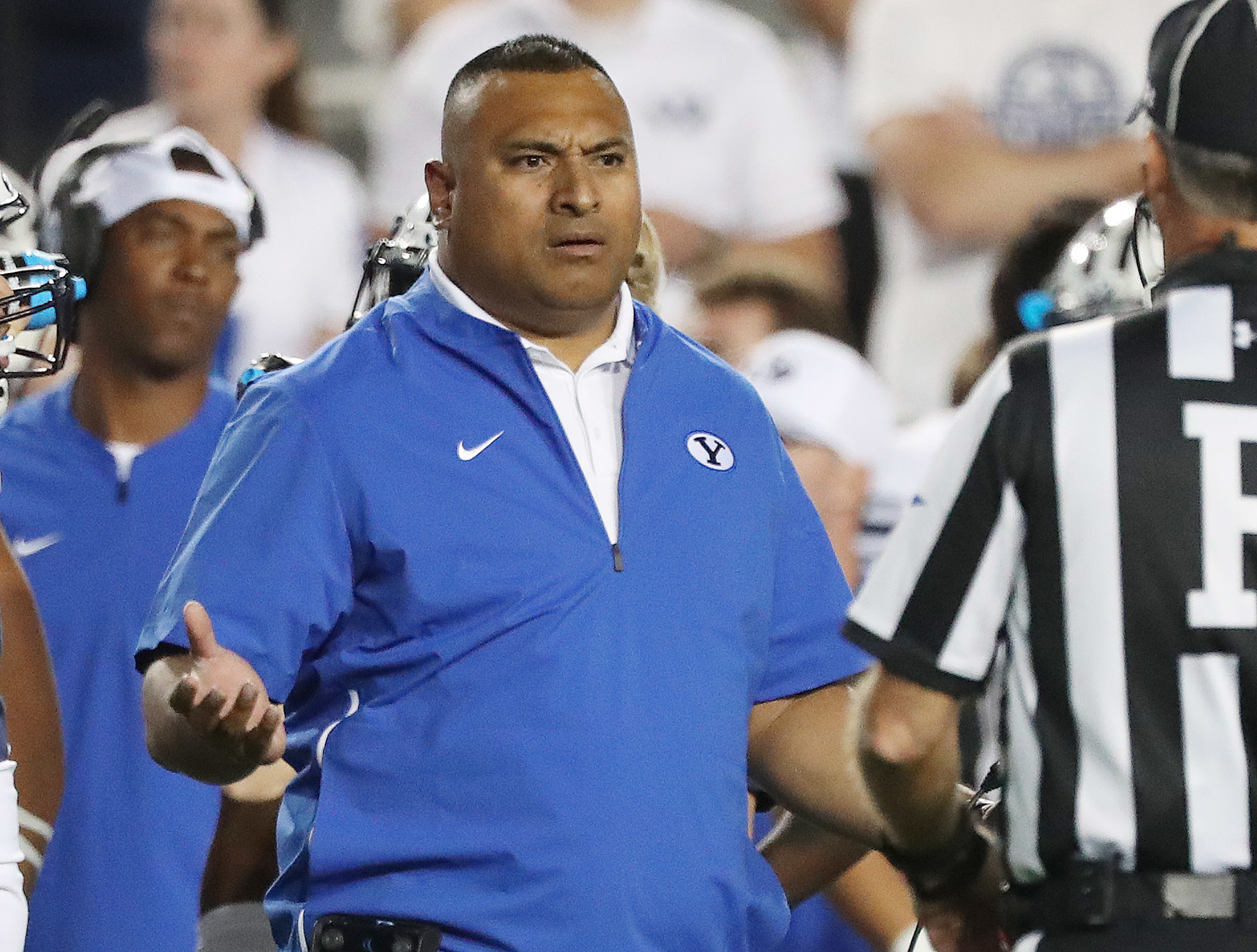 Brigham Young Cougars head coach Kalani Sitake protests the illegal touching call against the California Golden Bears in Provo on Saturday, Sept. 8, 2018.
