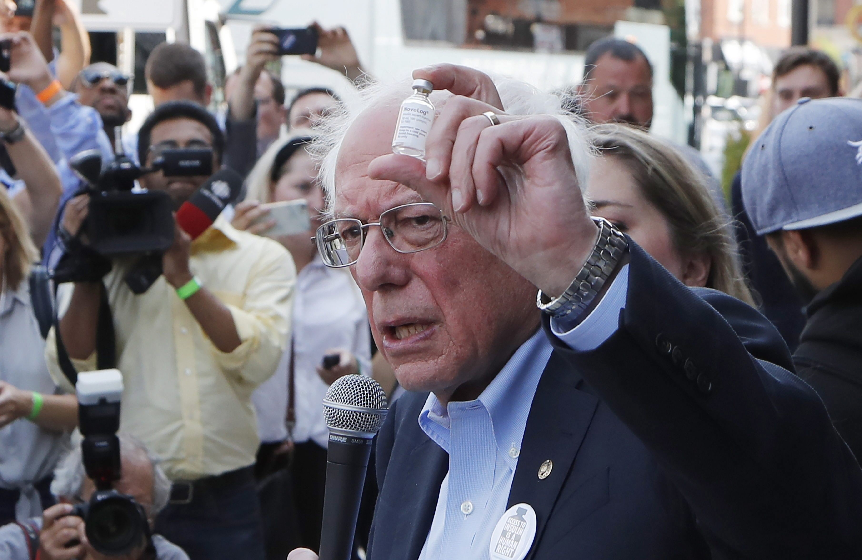 Democratic presidential candidate Sen. Bernie Sanders, I-Vt., holds an insulin vial as he addresses the media outside the Olde Walkersville Pharmacy, Sunday, July 28, 2019, in Windsor, Ontario. Sanders accompanied about a dozen people who purchased the dr