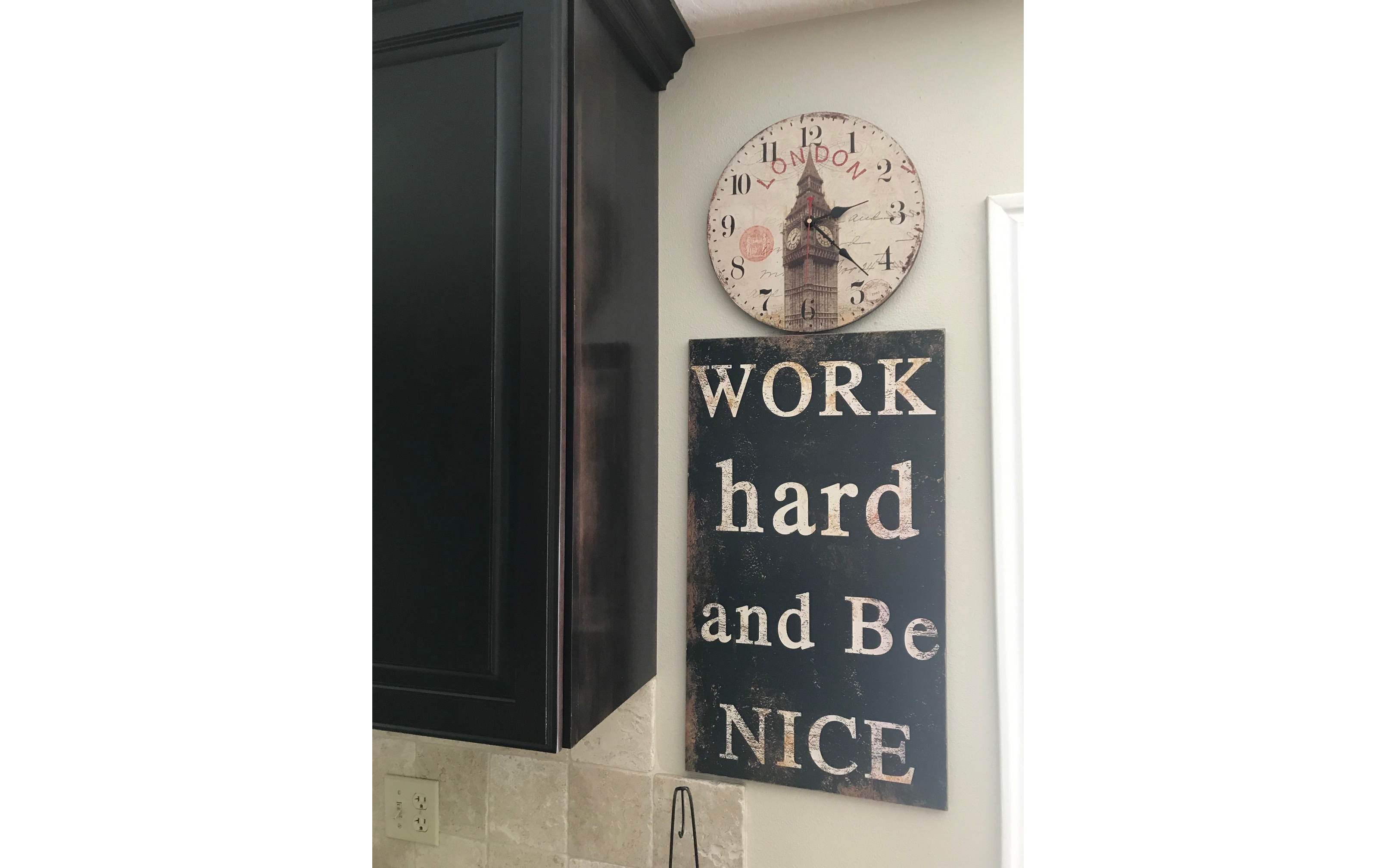 "This ""Work Hard and Be Nice"" sign hangs in Kristine Frederickson's home."