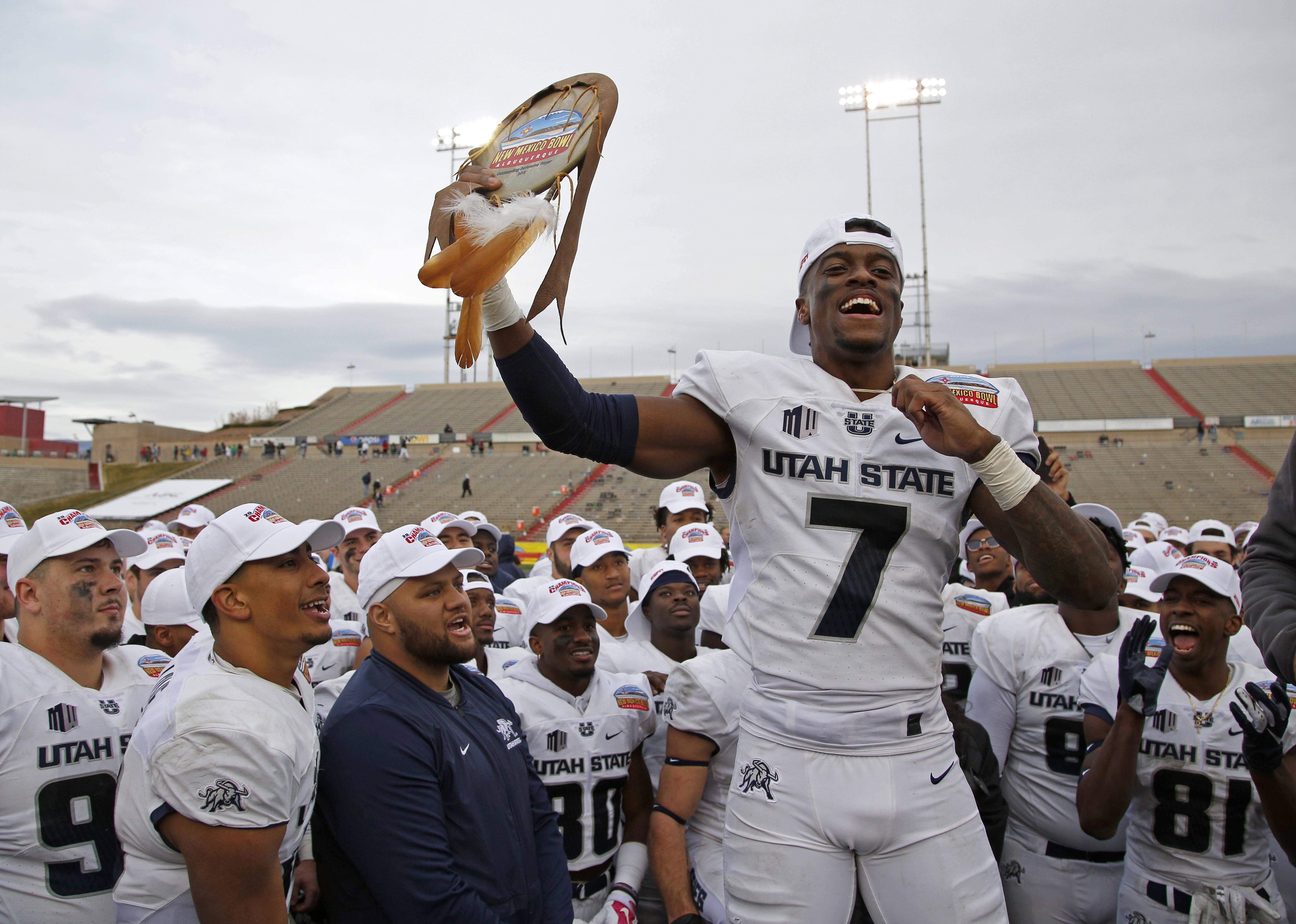 Utah State cornerback DJ Williams celebrates after being named the Outstanding Defensive Player of the New Mexico Bowl NCAA college football game in Albuquerque, N.M., Saturday, Dec. 15, 2018. Utah State beat North Texas 52-13. (AP Photo/Andres Leighton)