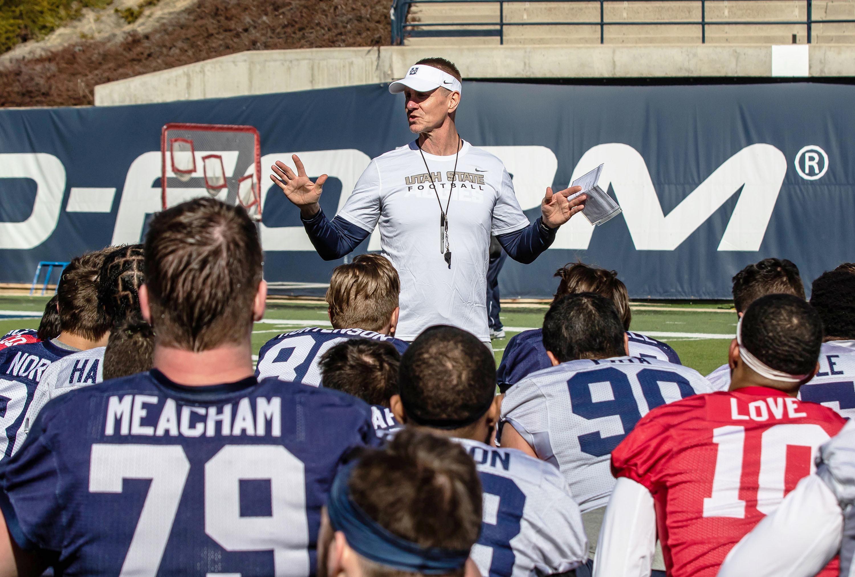 Utah State football coach Gary Andersen talks to the team during spring camp at Maverik Stadium in Logan.