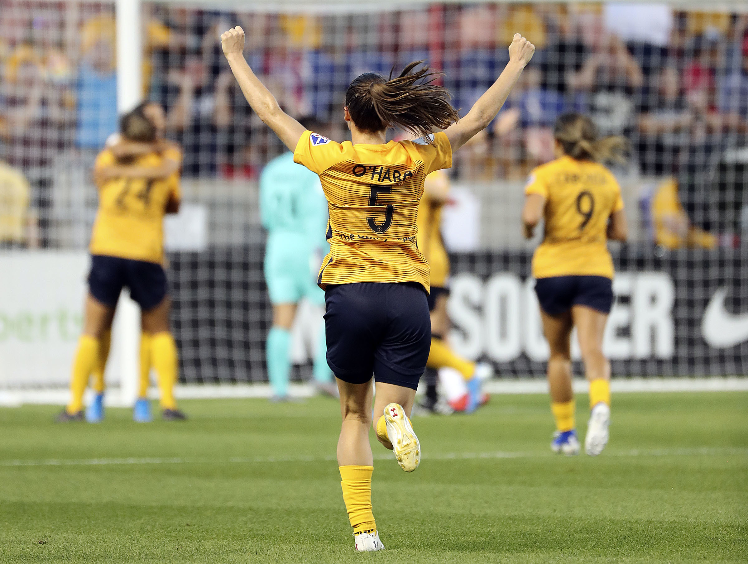 Utah Royals FC defender Kelley O'Hara (5) celebrates a Royals goal during a soccer game against the Portland Thorns FC in a soccer game at Rio Tinto Stadium in Sandy on Friday, July 19, 2019.