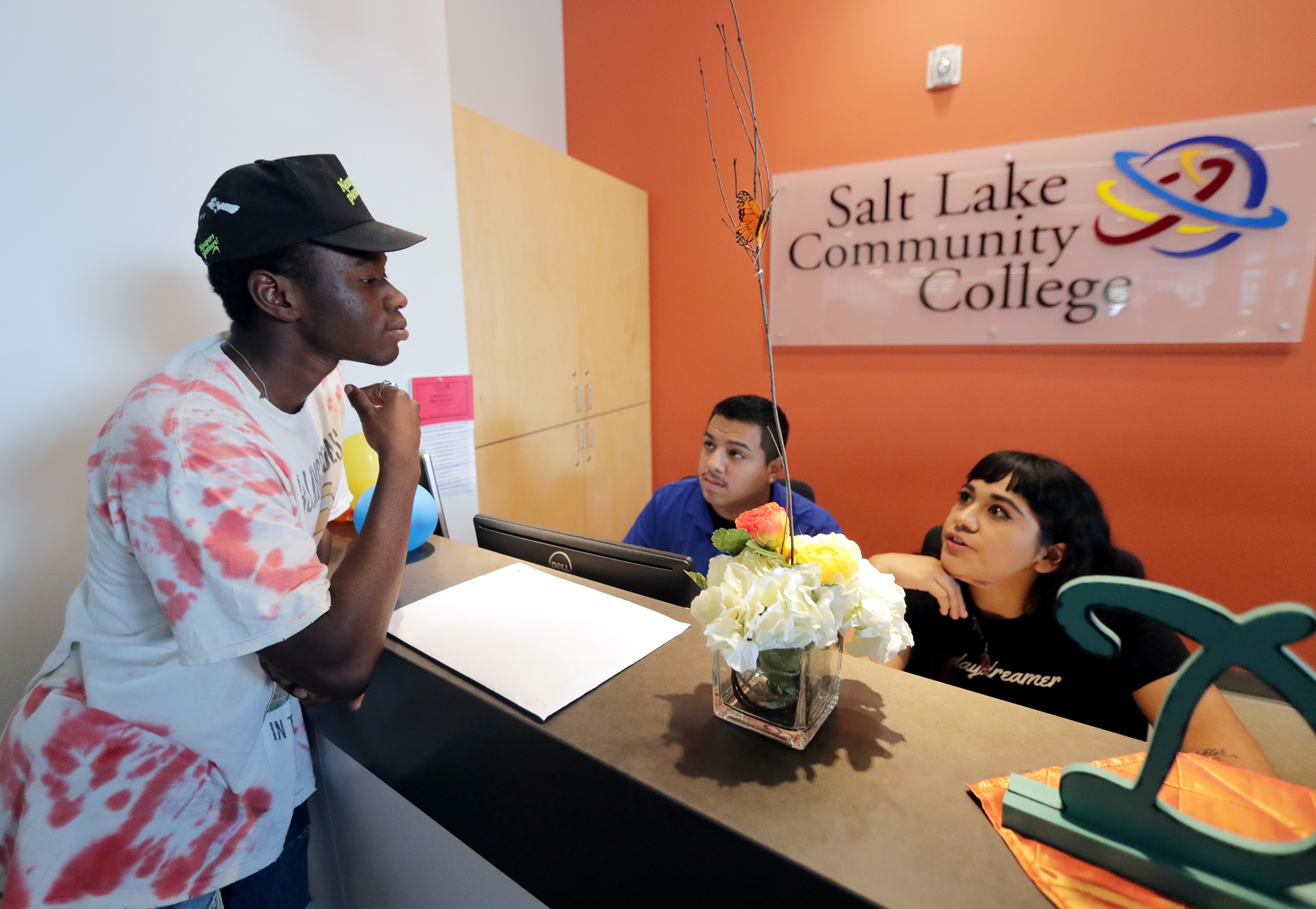 While looking for information about school, Elliott Tackie-Yarboi talks with Ricardo Hernandez and Brenda Santoyo at Salt Lake Community College's West Valley Center on Friday, Aug. 2, 2019. The center was intentionally opened in West Valley to bring coll